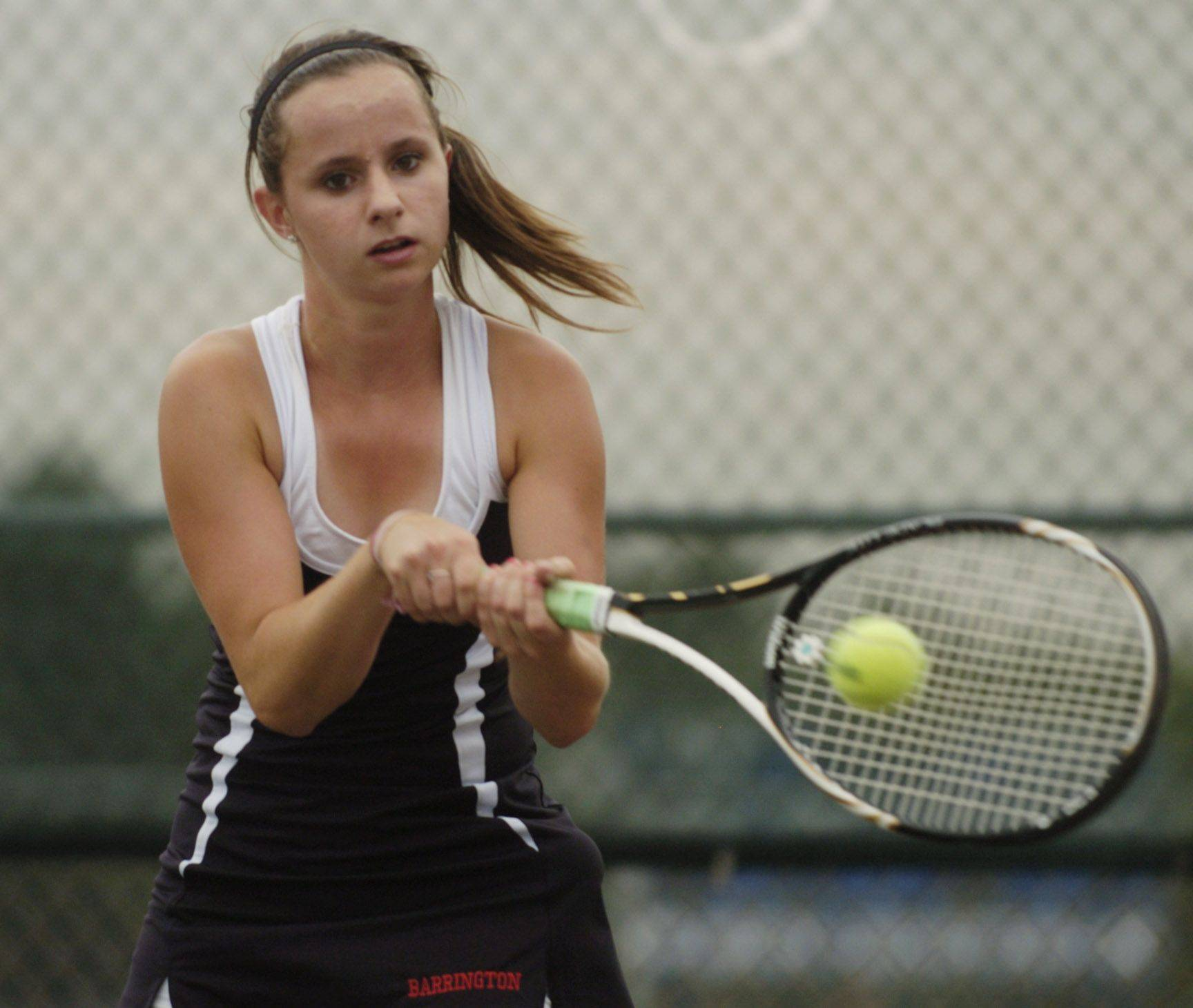 Barrington first singles player Lucia Stumbras returns a volley at Buffalo Grove on Tuesday.