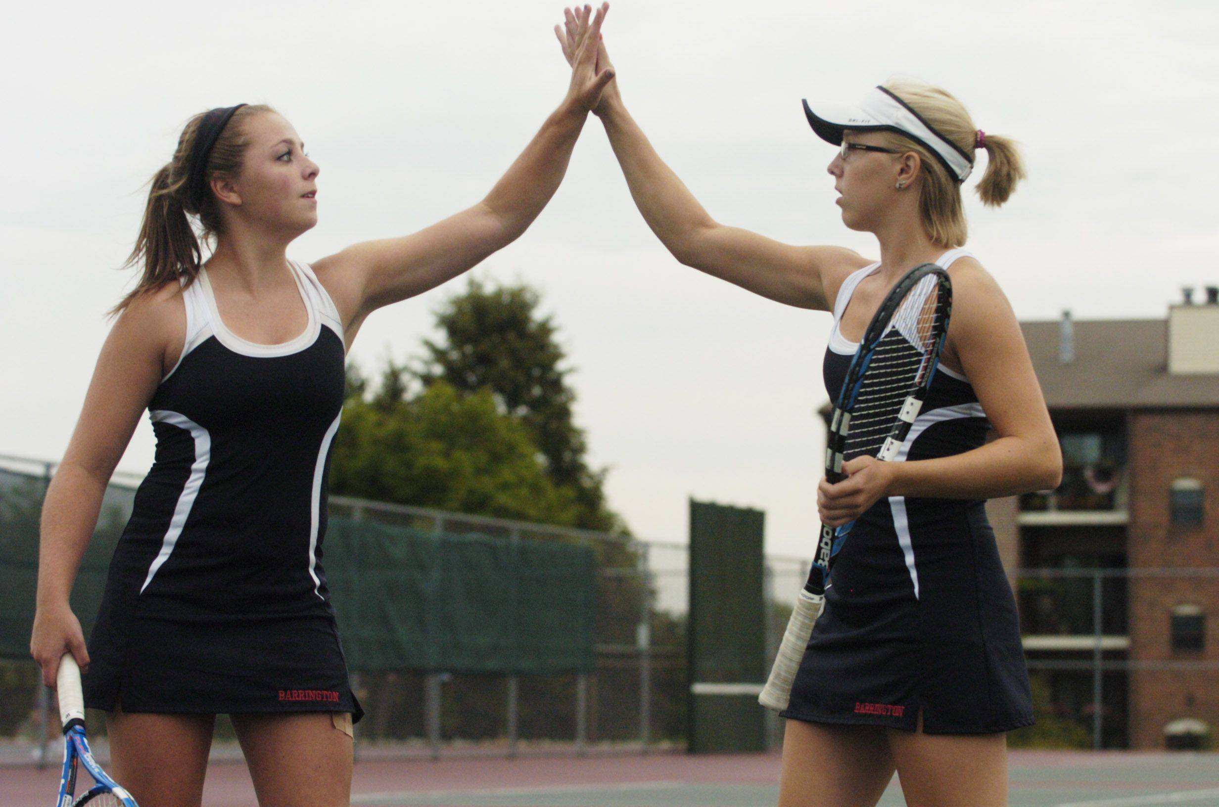 Barrington's Heather Ciskowski, left, and Zoe Kaziurak high-five one another after a point at Buffalo Grove Tuesday.