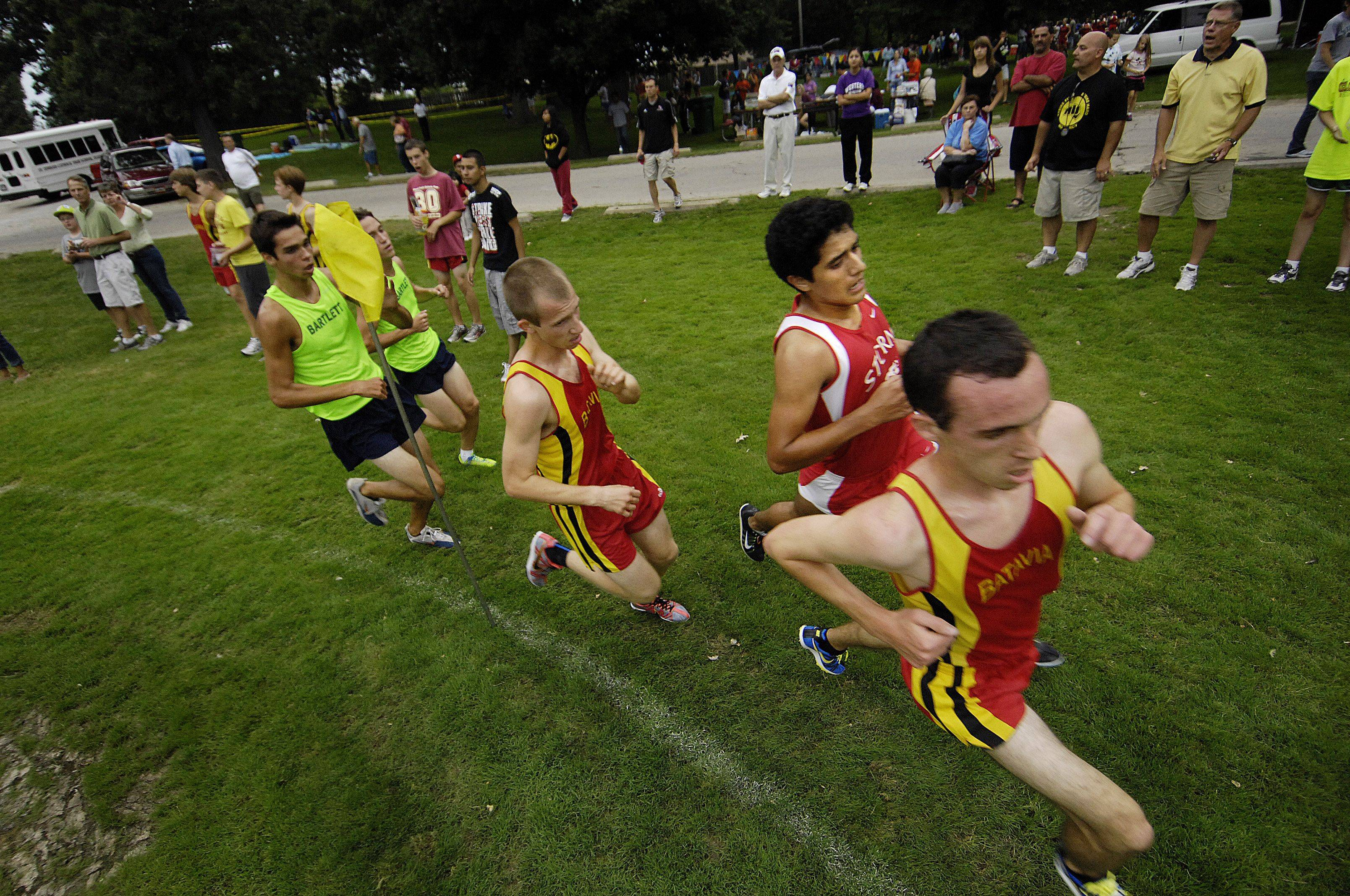 Eventual winner Fernando Garcia of South Elgin rounds a late corner in second place during the Elgin cross country invitational Tuesday at Lords Park. He is surrounded by Batavia teammates Mike Redmond in front, who eventually finished third, and Chris Spadafora who finished fourth. Behind them are Bartlett teammates Joey Salatino, who finished second and Connor Rachford who finished fifth.