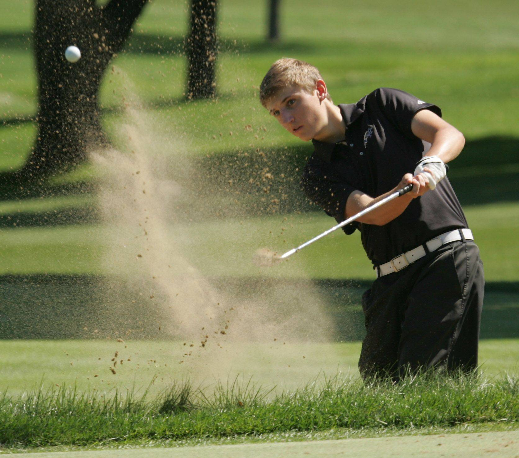 St. Charles North senior John Carroll places a near-perfect sand shot within a foot of the cup Monday morning during the McChesney Classic golf tournament at Geneva Golf Club.