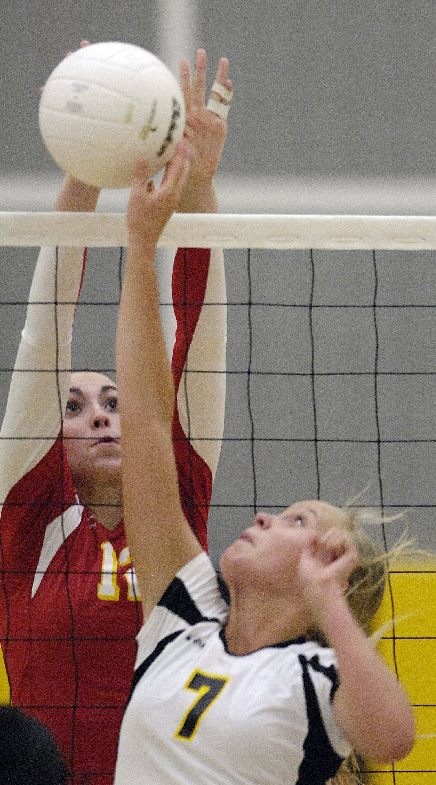 Batavia's Shea Thayer blocks a tip at the net by Metea Valley's Ellie Petersen Thursday.