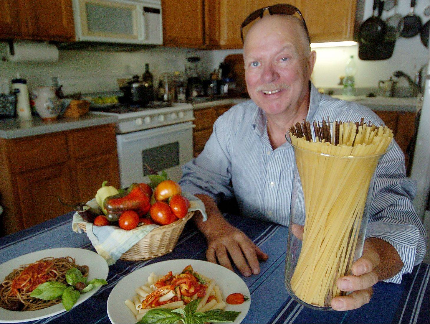 Bob Chwedyk/bchwedyk@dailyherald.com Cook of the Week challenge contestant Antonio DePau with his favorite ingredient pasta.