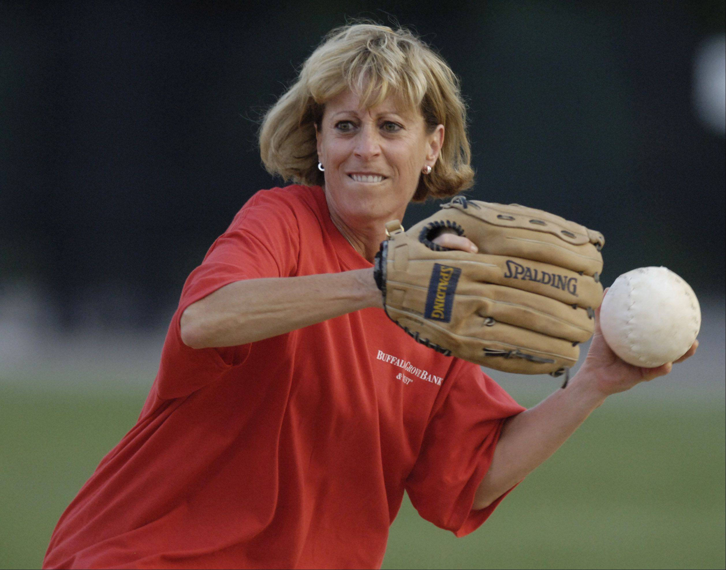Robyn Kove of Midtown Athletic Club makes a throw from second base.