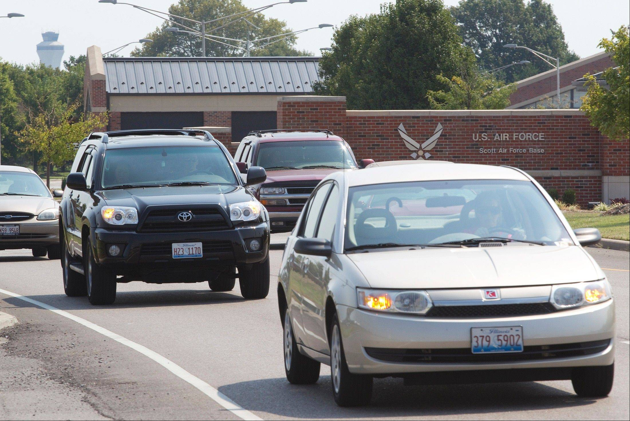 Associated Press Traffic leaves through the main gate at Scott Air Force Base in Mascoutah, Ill., Wednesday after a suspicious package was found on the base. Three people from the base in southwestern Illinois were hospitalized, and about 100 were evacuated.