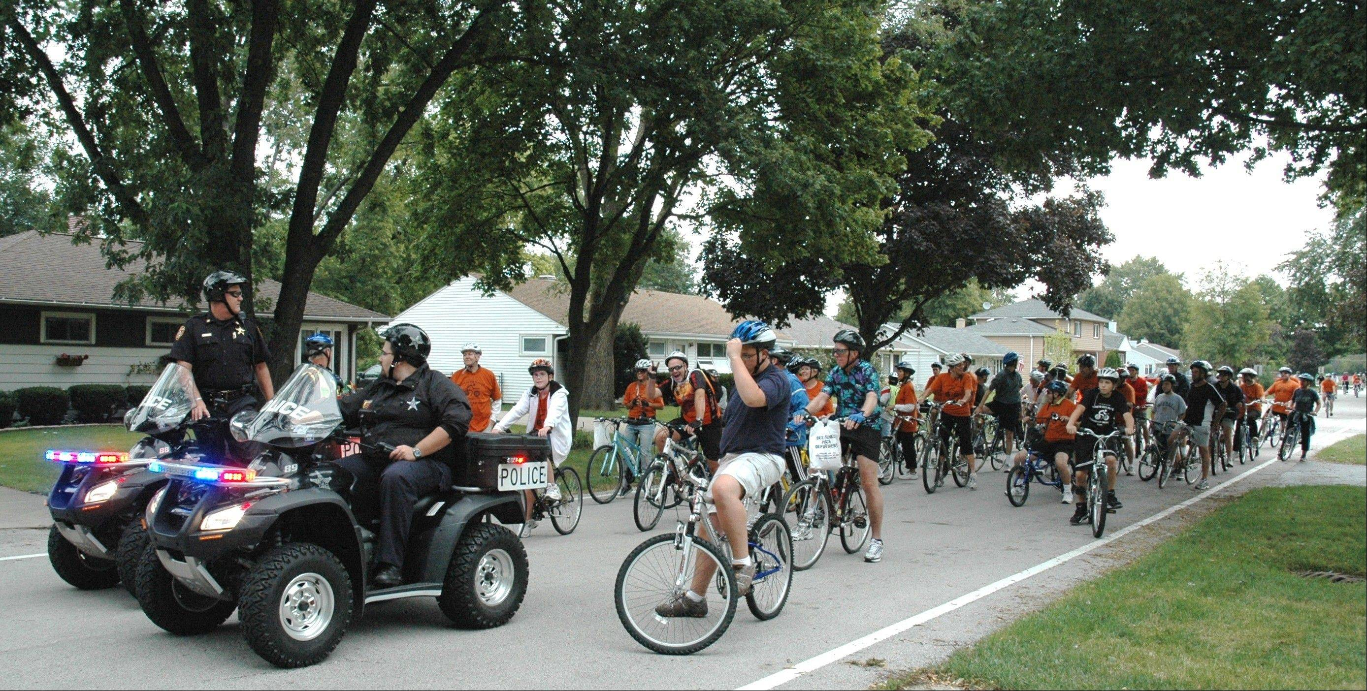Des Plaines Police officers lead a previous Tour De Des Plaines Bike Ride. This year�s nine-mile, police escorted, family friendly ride will take place Saturday, Sept. 17, leaving from Lake Park, at Howard and Lee streets, in Des Plaines.