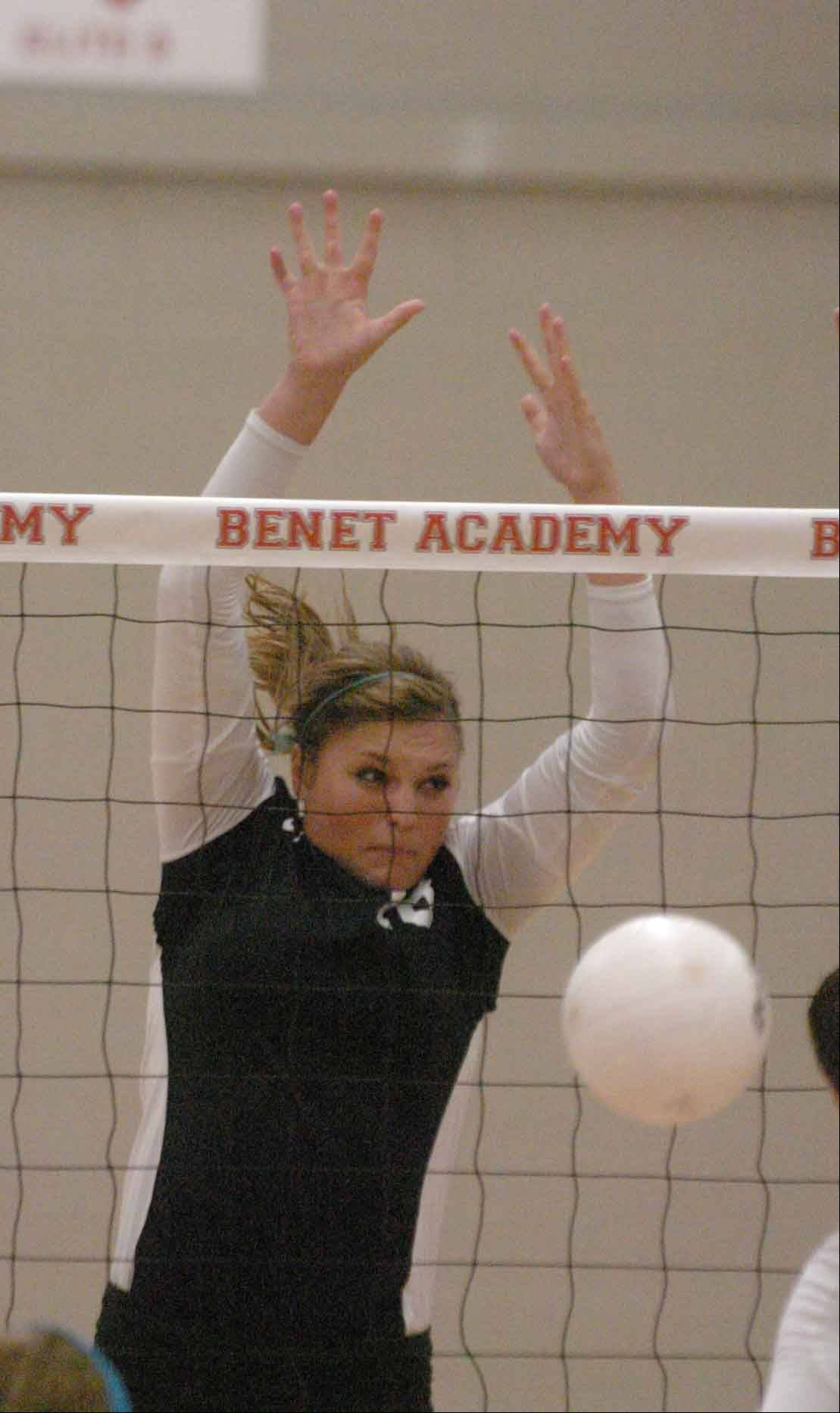Sam Schrenker of York during the York at Benet girls volleyball game in Lisle Wednesday.