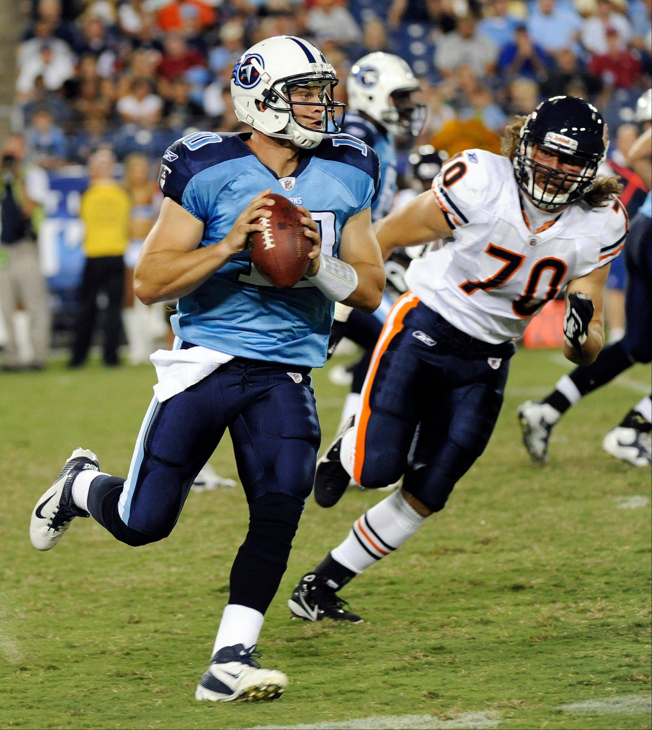 Defensive end Nick Reed chases Tennessee quarterback Jake Locker during the Bears' third preseason game on Aug. 27. Reed is hoping for a good showing Thursday against Cleveland to secure a spot on the team's 53-man roster.