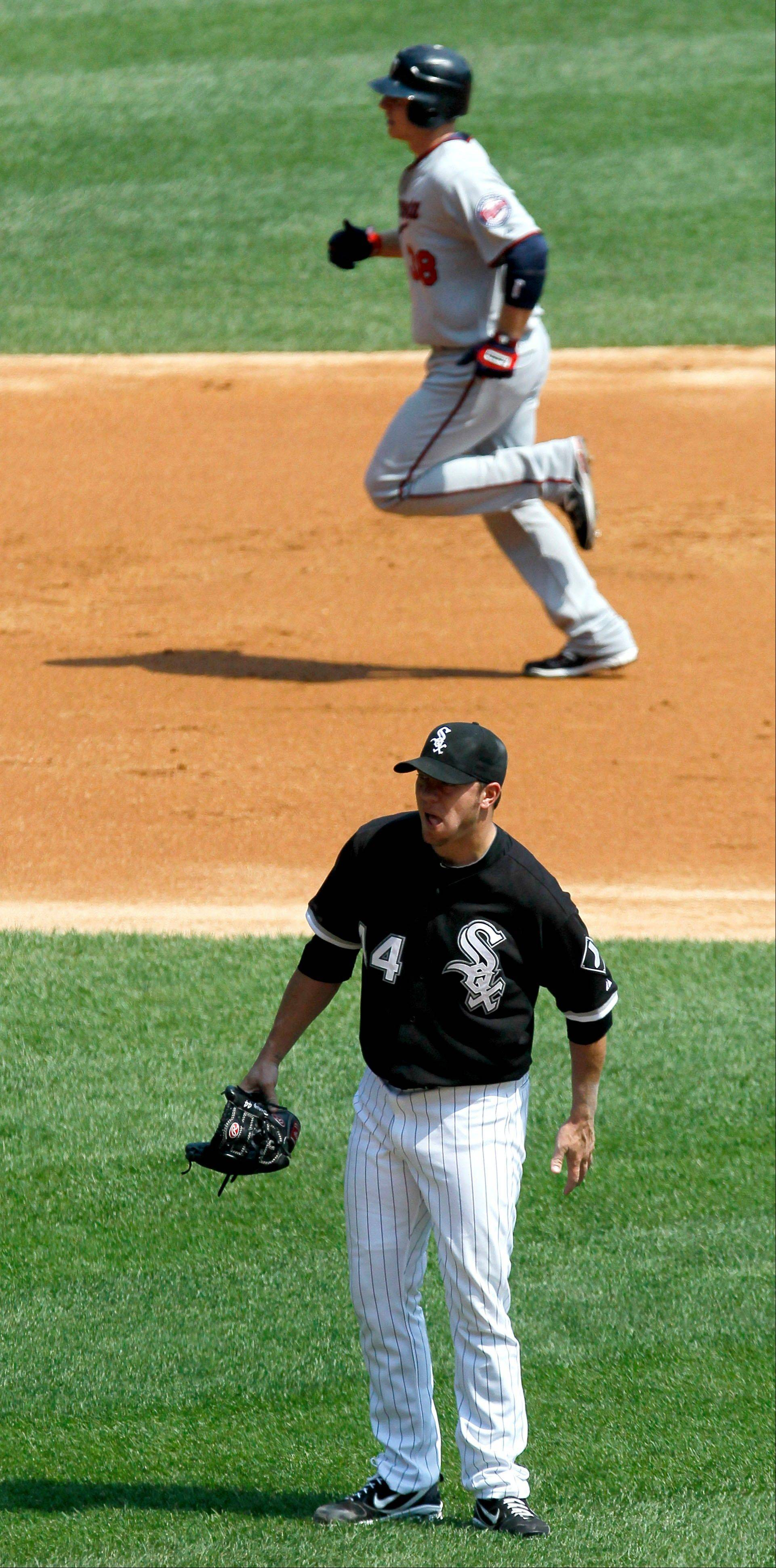 White Sox starting pitcher Jake Peavy returns to the mound after giving up a 2-run home run to Luke Hughes during Minnesota's 6-run first inning Wednesday afternoon at U.S. Cellular Field.