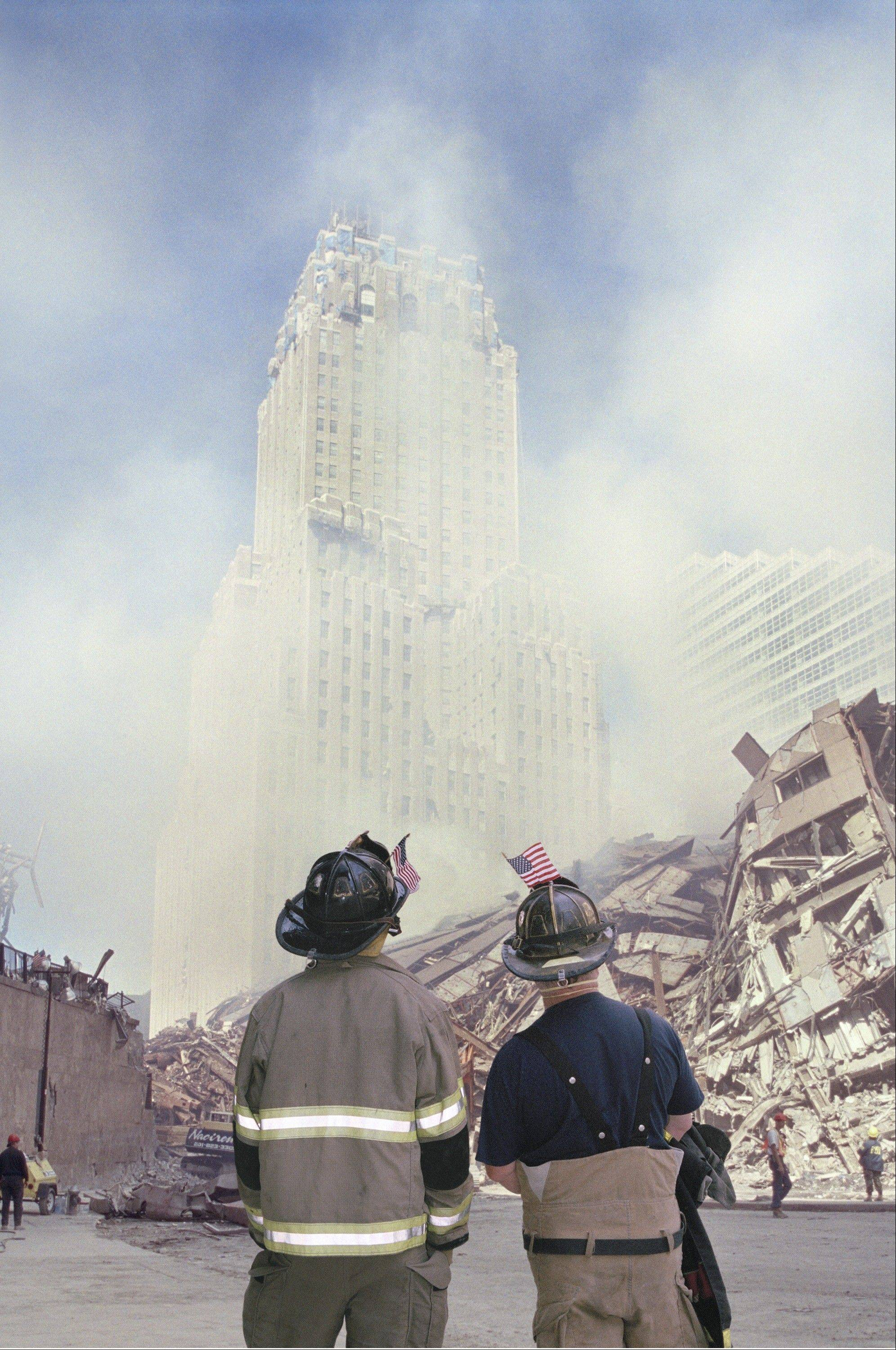 "The exhibit ""Ground Zero 360°"" at the Field Museum of Natural History in Chicago includes a photo of New York firefighters surveying the destruction four days after Sept. 11, 2001, terrorist attacks."