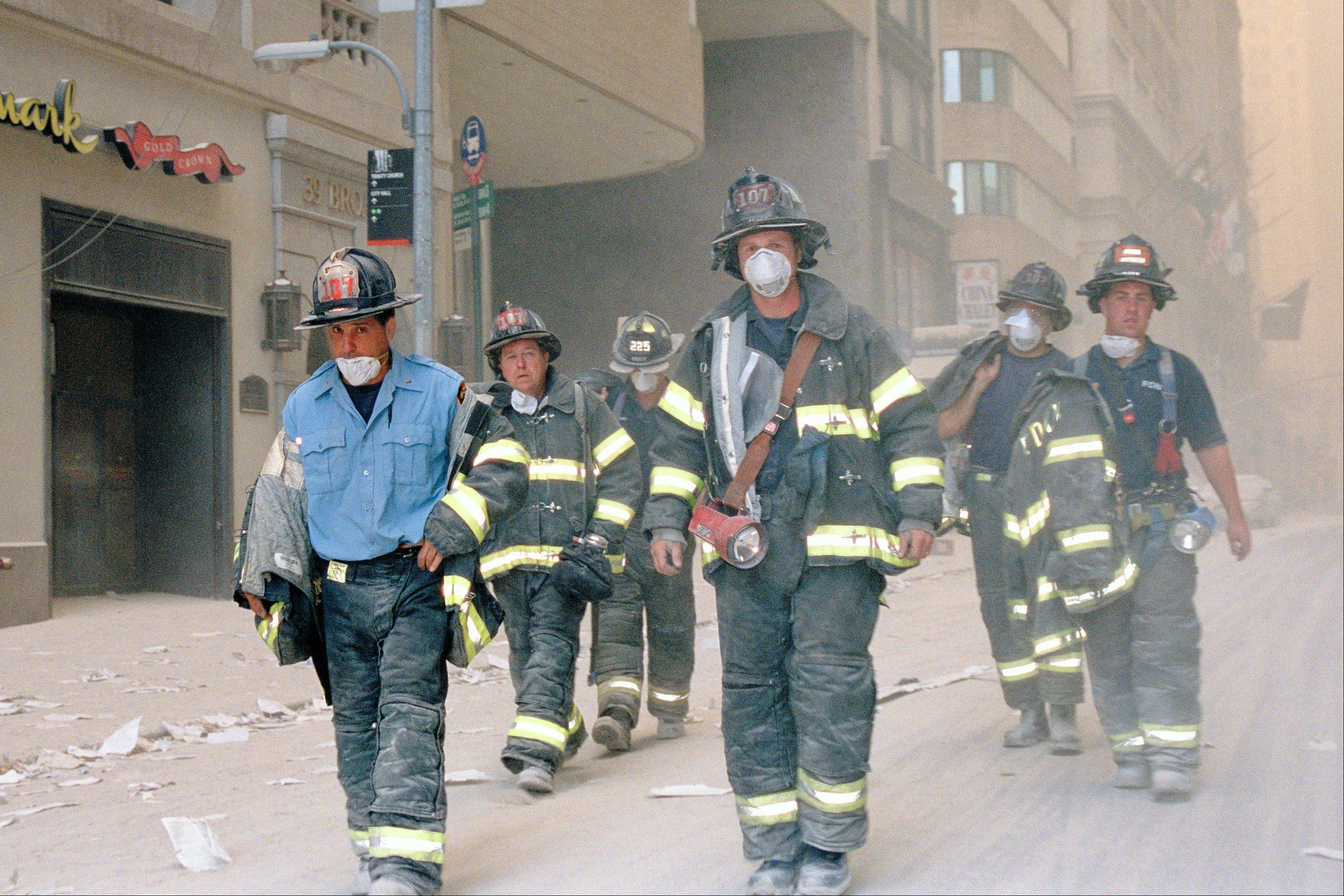 "The exhibit ""Ground Zero 360°"" at the Field Museum of Natural History in Chicago features a photo of New York firefighters several hours after the World Trade Center towers collapsed on Sept. 11, 2001."