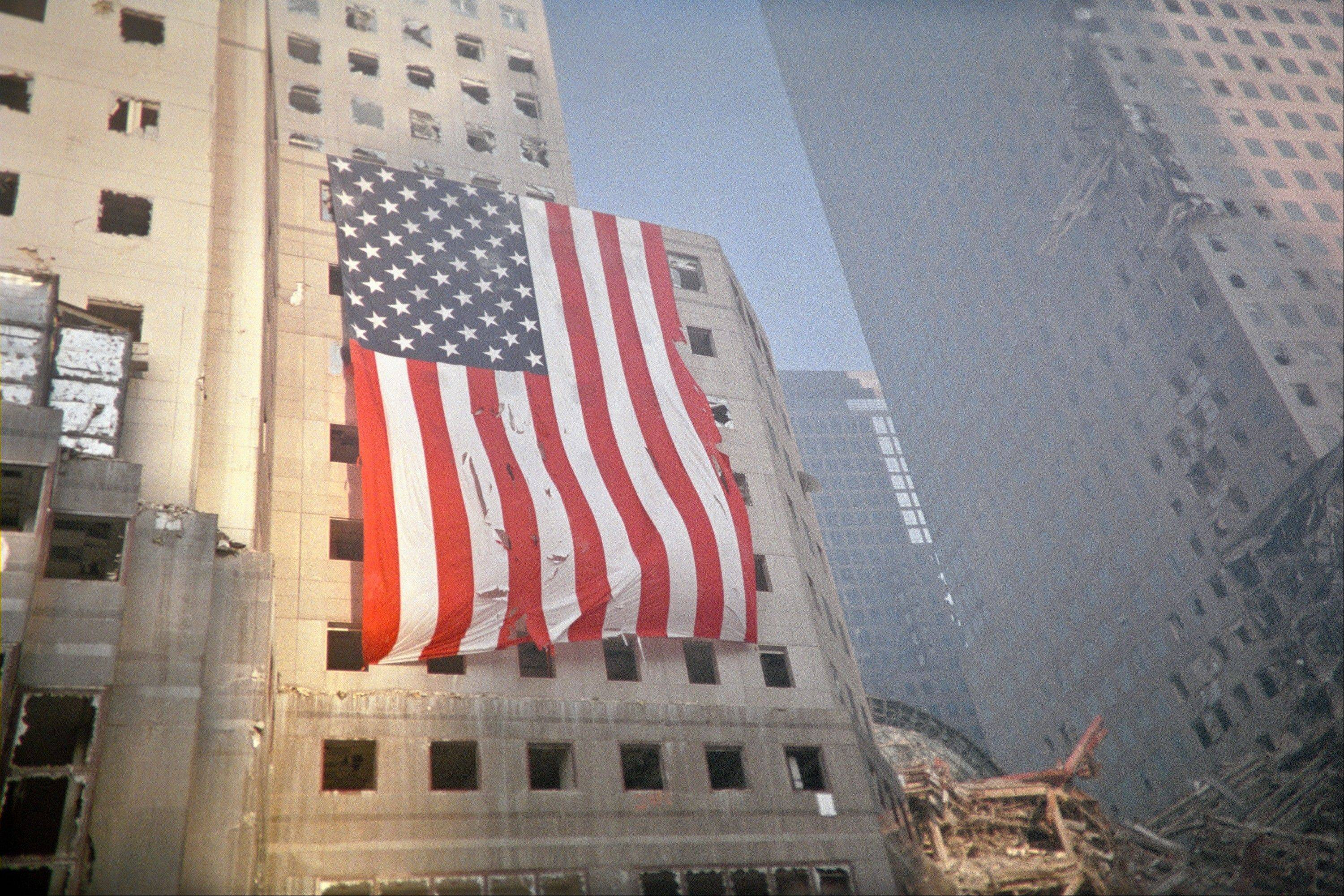 "The exhibit ""Ground Zero 360°"" at the Field Museum of Natural History in Chicago features a photo of an American flag draped from the World Financial Center, a building that sustained damage from the collapse of the World Trade Center towers on Sept. 11, 2001."