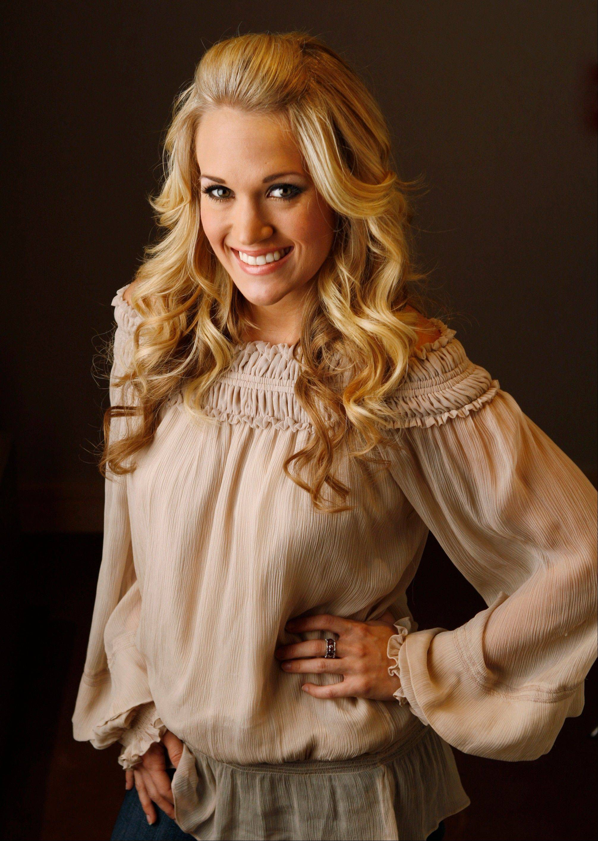 Country music singer Carrie Underwood returns to the Ravinia Festival in Highland Park.