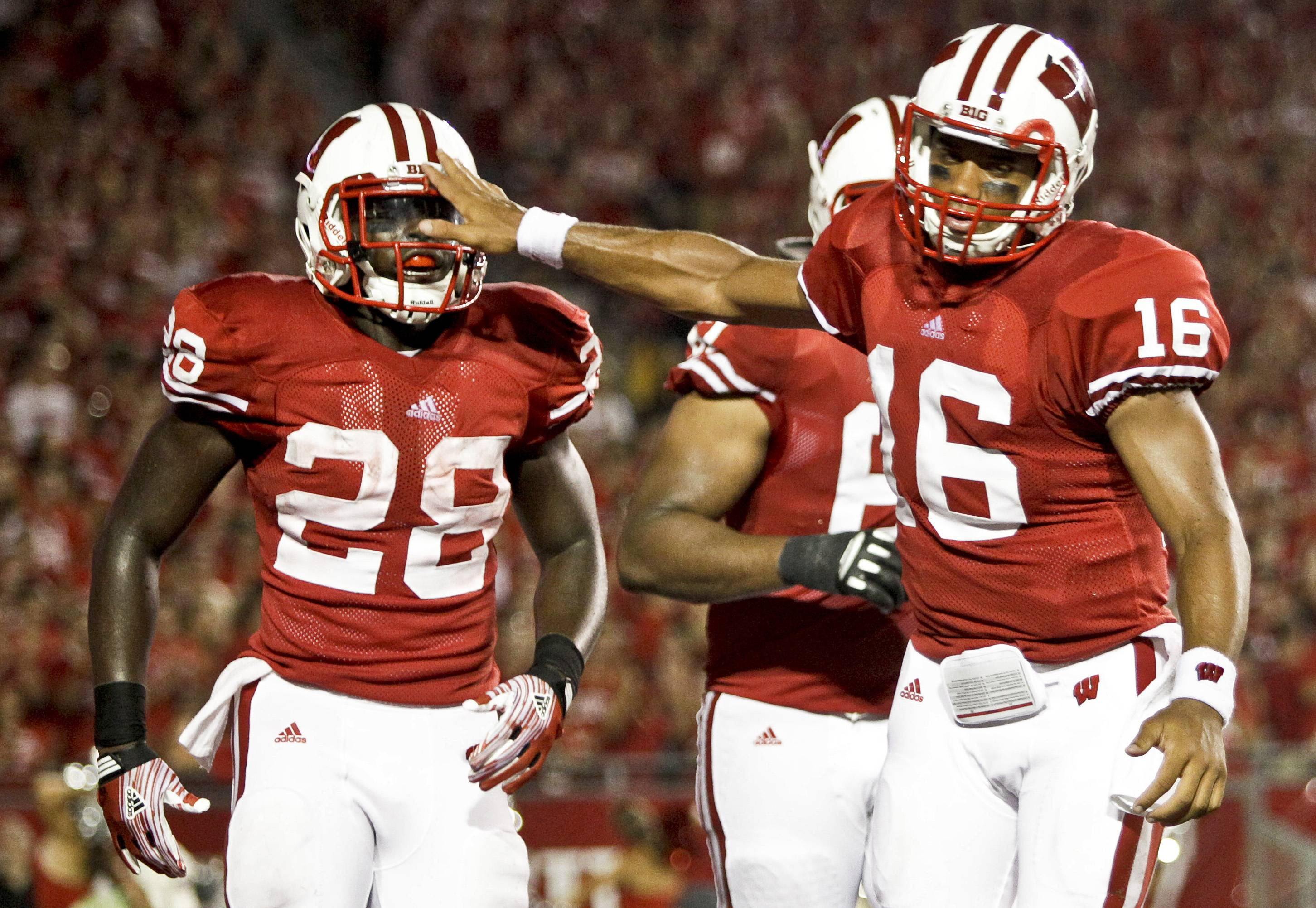 Wisconsin quarterback Russell Wilson (16) congratulates running back Montee Ball (28) after Ball's touchdown run during the first half Thursday night.