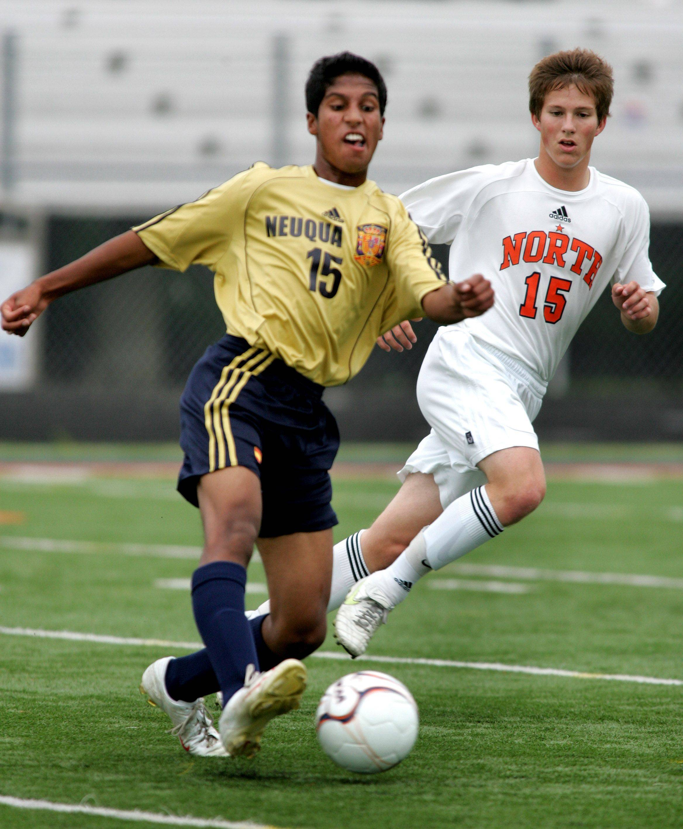 Bev Horne/bhorne@dailyherald.com Paarth Joshl of Neuqua Valley, left, takes control of the ball from Zach Peterson of Naperville North in boys soccer action Tuesday in Naperville.