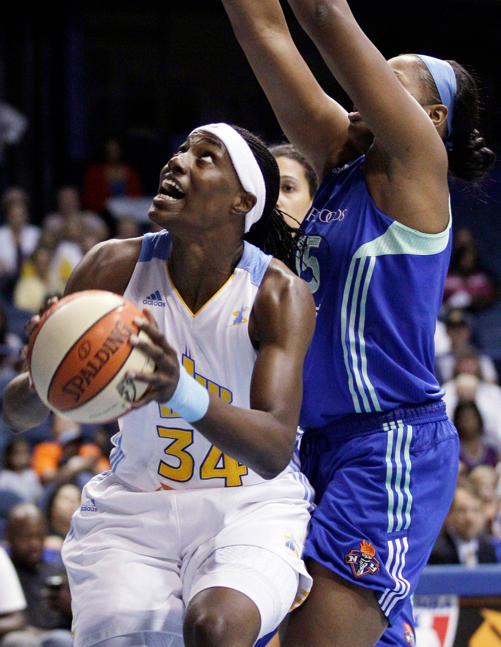 Chicago Sky�s Sylvia Fowles, left, looks to the basket as New York Liberty�s Kia Vaughn guards her in their WNBA basketball game on Sunday at Allstate Arena. Fowles was named Player of the Month for August for the Eastern Conference.