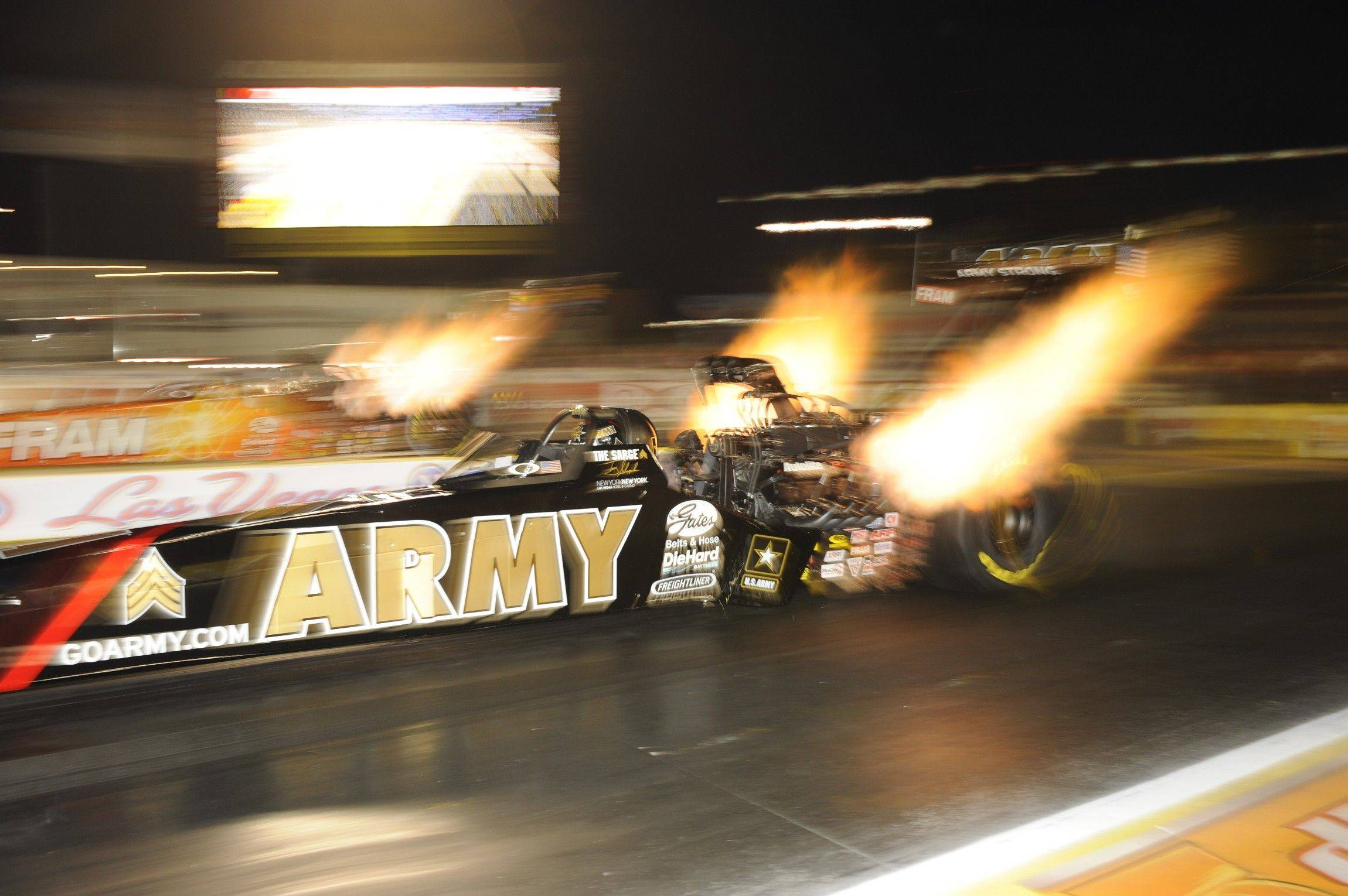 In this photo provided by NHRA, Tony Schumacher sets a track record for speed in his U.S. Army dragster and takes the top spot in Top Fuel at the NHRA Las Vegas Nationals auto race at The Strip at Las Vegas Motor Speedway on Friday, Oct. 29, 2010. (AP Photo/NHRA, Jerry Foss) ** NO SALES **