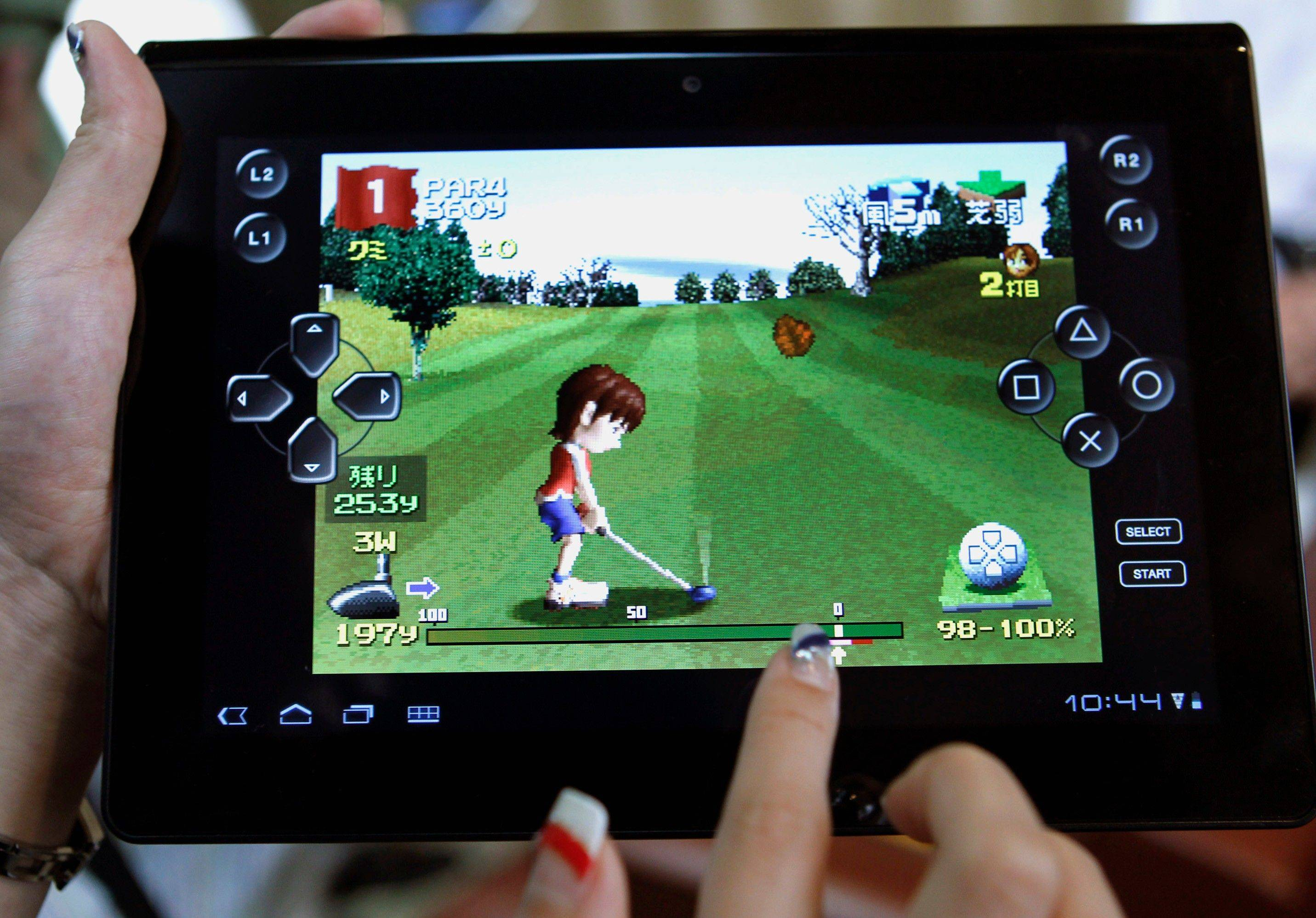A models plays a game on Sony's new tablet computer Tablet S during a launch event in Tokyo, Thursday. The wedge-shaped Tablet S, about the size of an iPad, can double as a universal remote control. Sony said the Tablet S is going on sale on Sept. 17 in Japan.