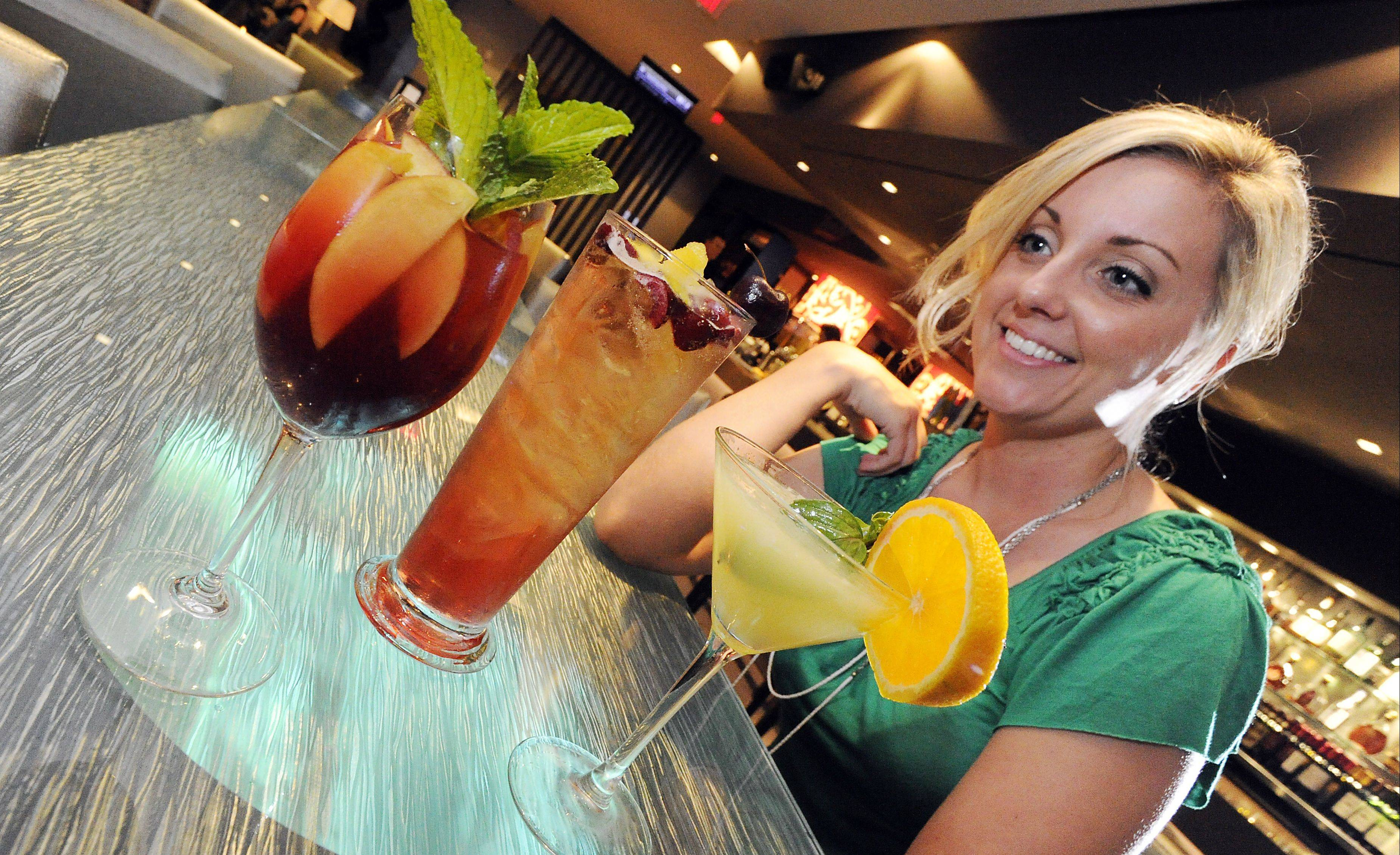 Brittney Block has a hard time deciding between the Windy City Summer Peach, Chicago Cherry Brew and the Local Luxe Lemon Drop at Salt Sports Bar.