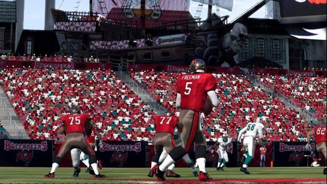 "Virtual Tampa Bay Bucs quarterback Josh Freeman drops back to look for an open receiver in ""Madden NFL 12."""