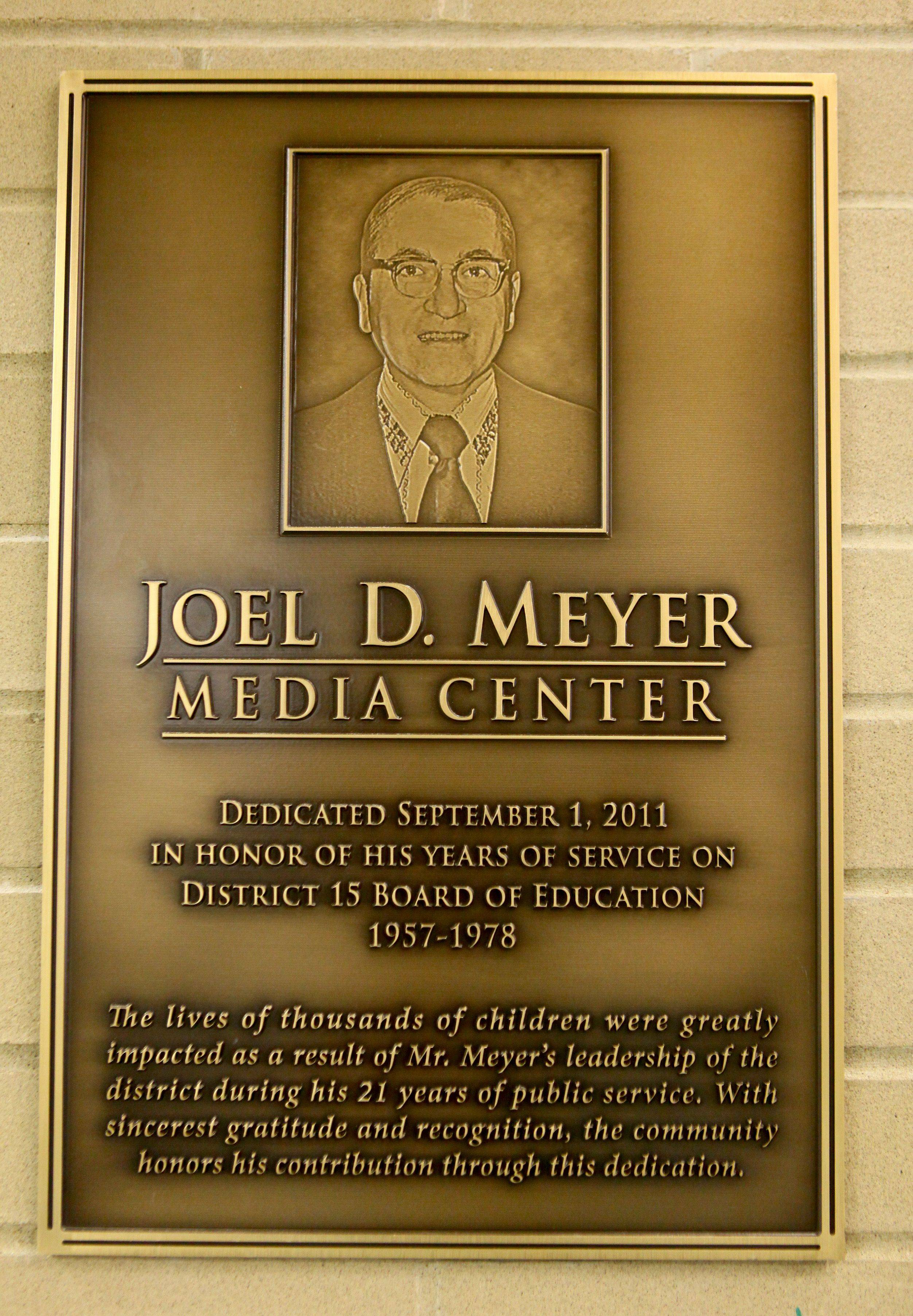 The plaque dedicated to Joel Meyer is placed outside the new media center at Carl Sandburg Junior High in Rolling Meadows. The junior high celebrated its 50th anniversary Thursday afternoon.