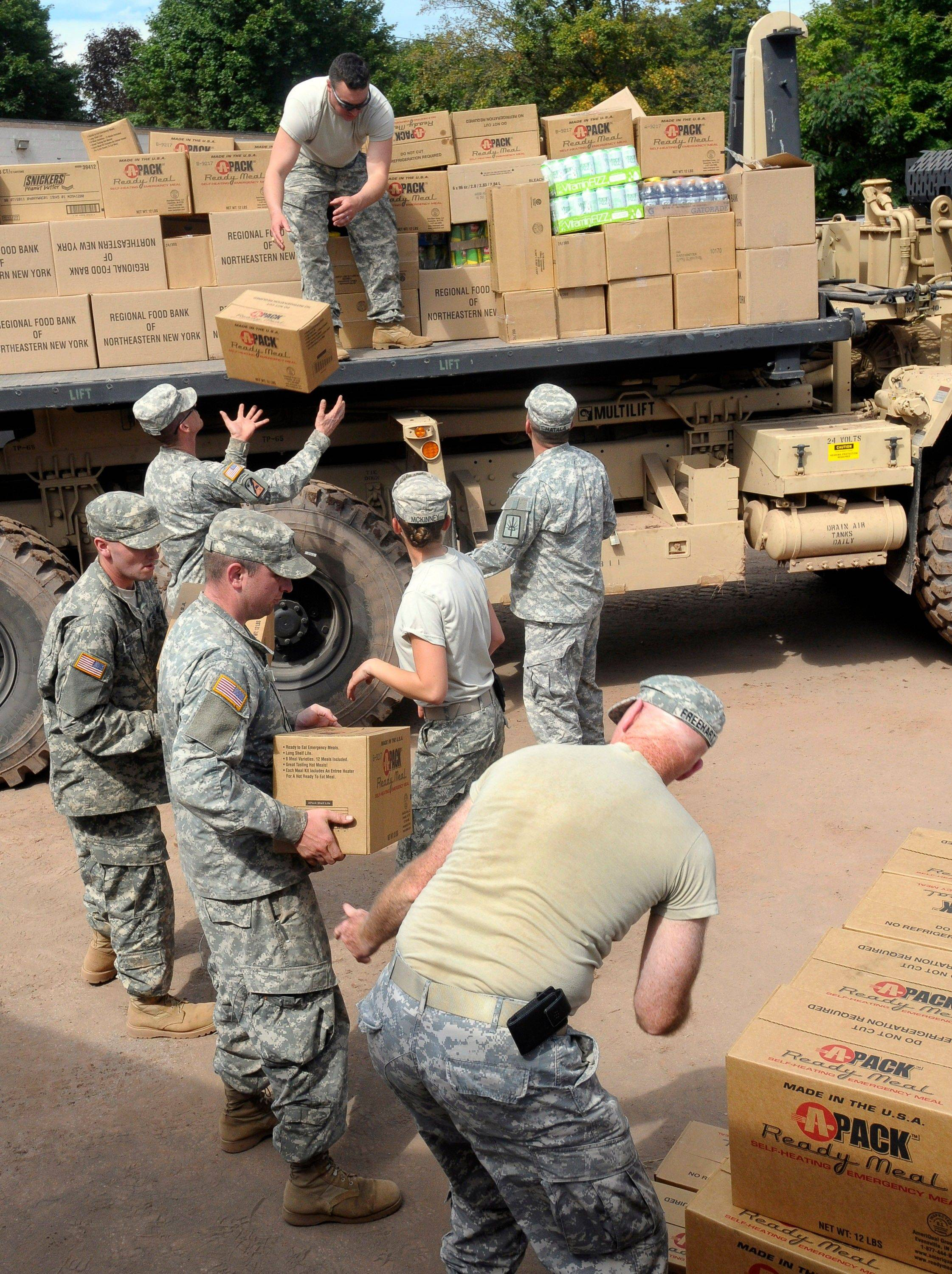 New York National Guard members unload food and water for flood victims of Tropical Storm Irene in Prattsville, N.Y., Wednesday. Tropical Storm Irene put a $1 billion whipping on New York, most of it upstate where heavy rains spawned flash floods that shredded roads, washed out bridges and knocked buildings from their foundations, Gov. Andrew Cuomo said Wednesday.