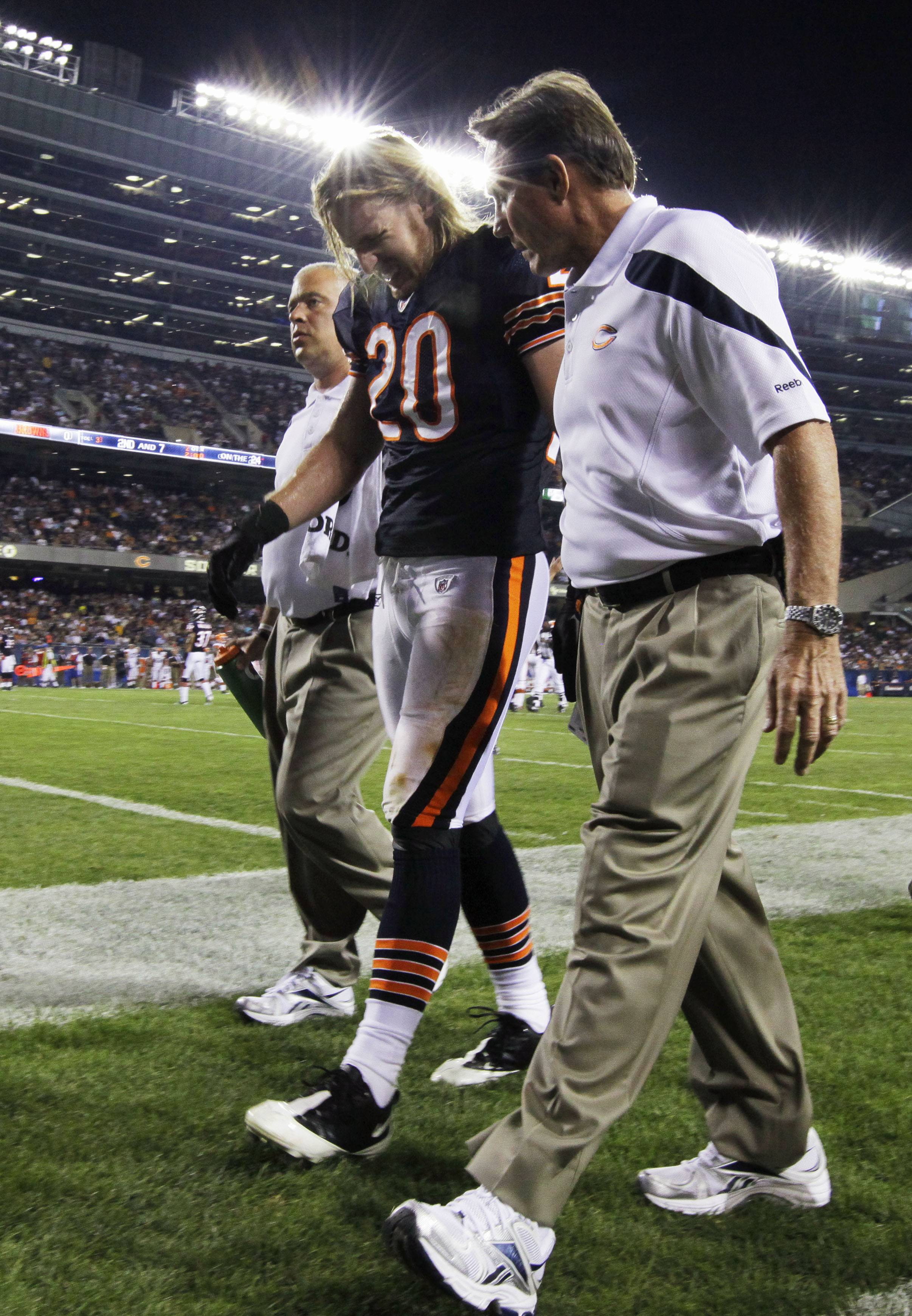 Craig Steltz is helped from the field after getting injured in the first half Thursday night against the Cleveland Browns.