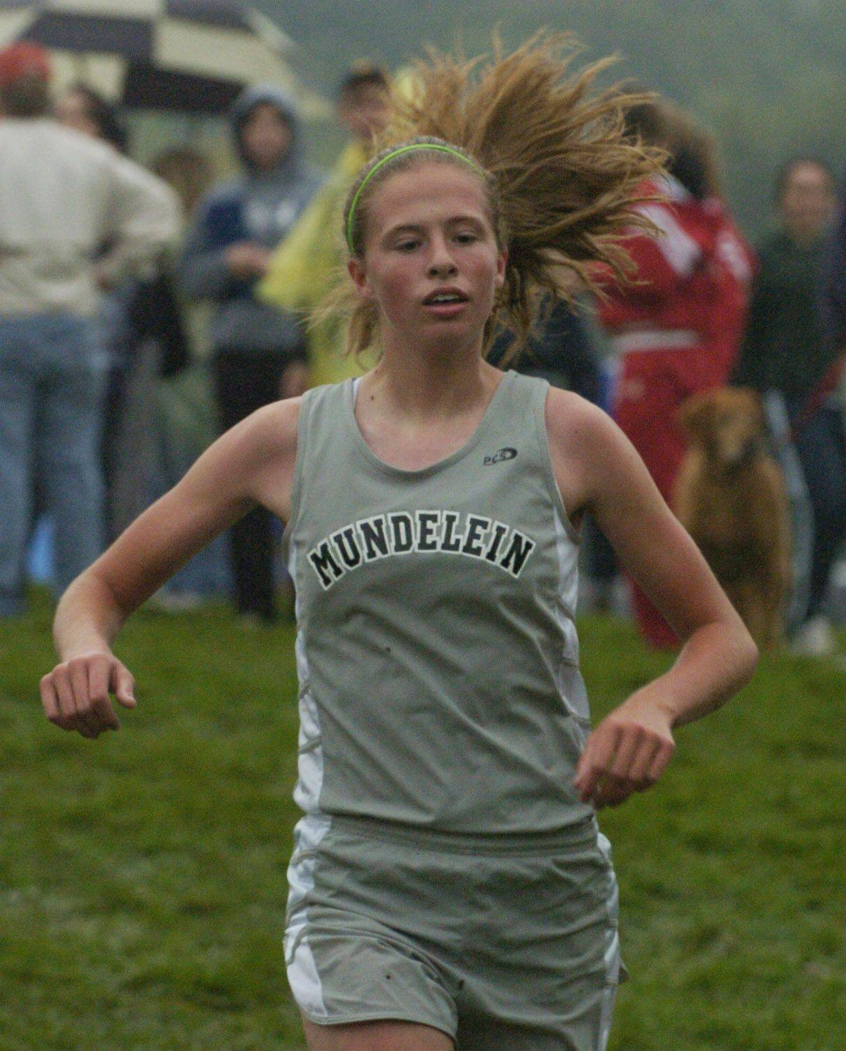 Marisa Perreault returns from a sixth-place North Suburban Conference finish to lead Mundelein this fall. Here, she runs downhill during the Wauconda Invitational at Lakewood Forest Preserve last season.