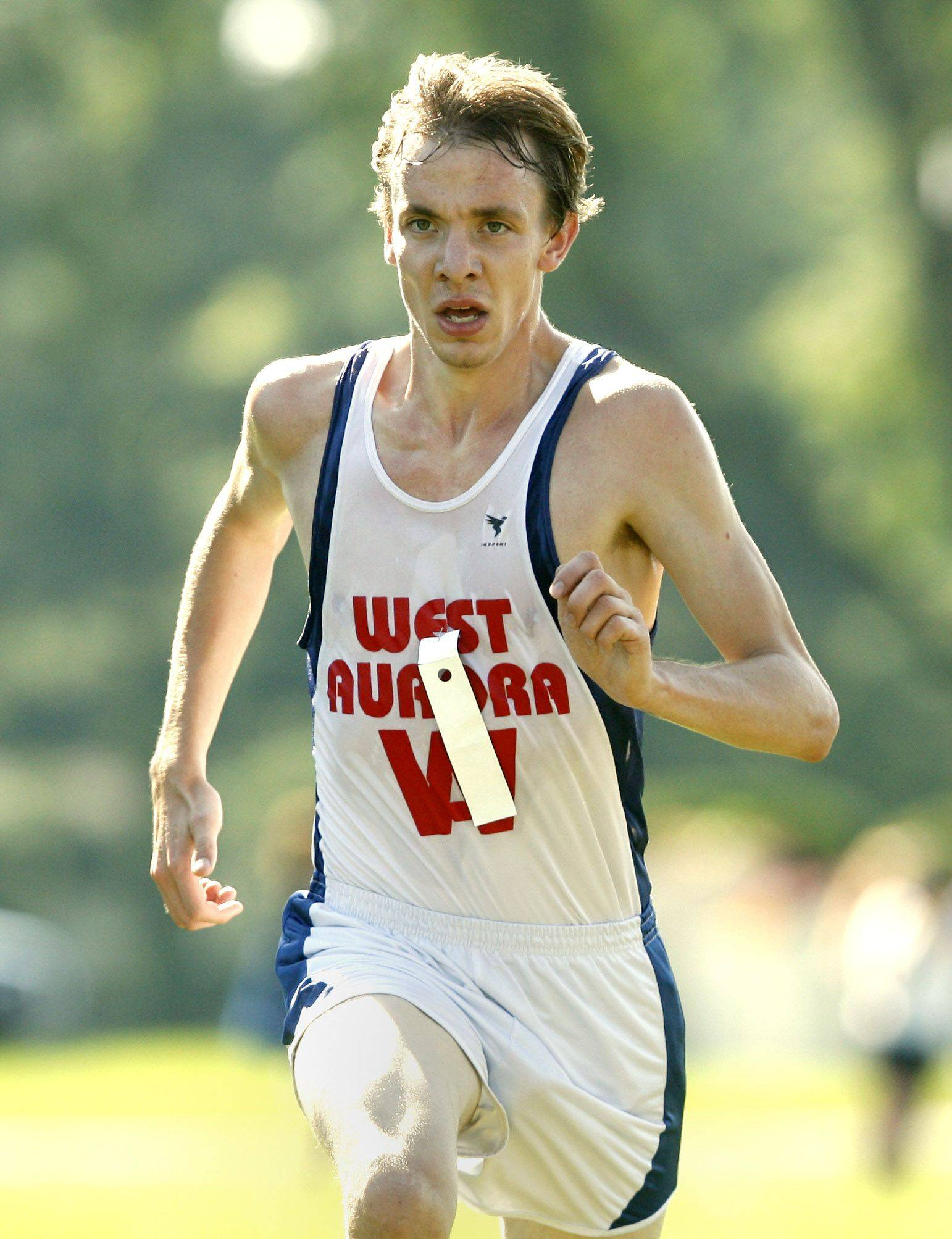 West Aurora's Josh Robinson finishes second during a cross country meet at Marmion High School.