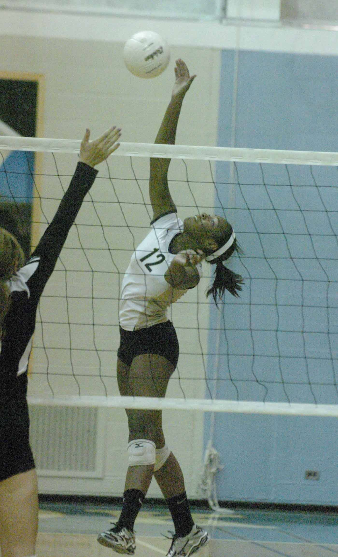 Destini Wade of Glenbard North hits one during the Glenbard North at Willow Brook Girls volleyball game Thursday.