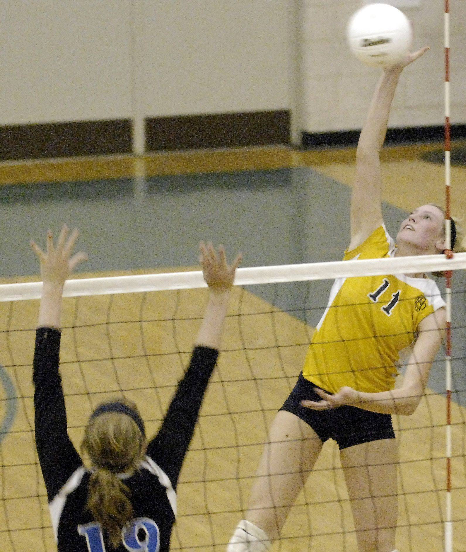 Neuqua Valley's Callie Huebener hits from the outside during Thursday's game in Geneva.
