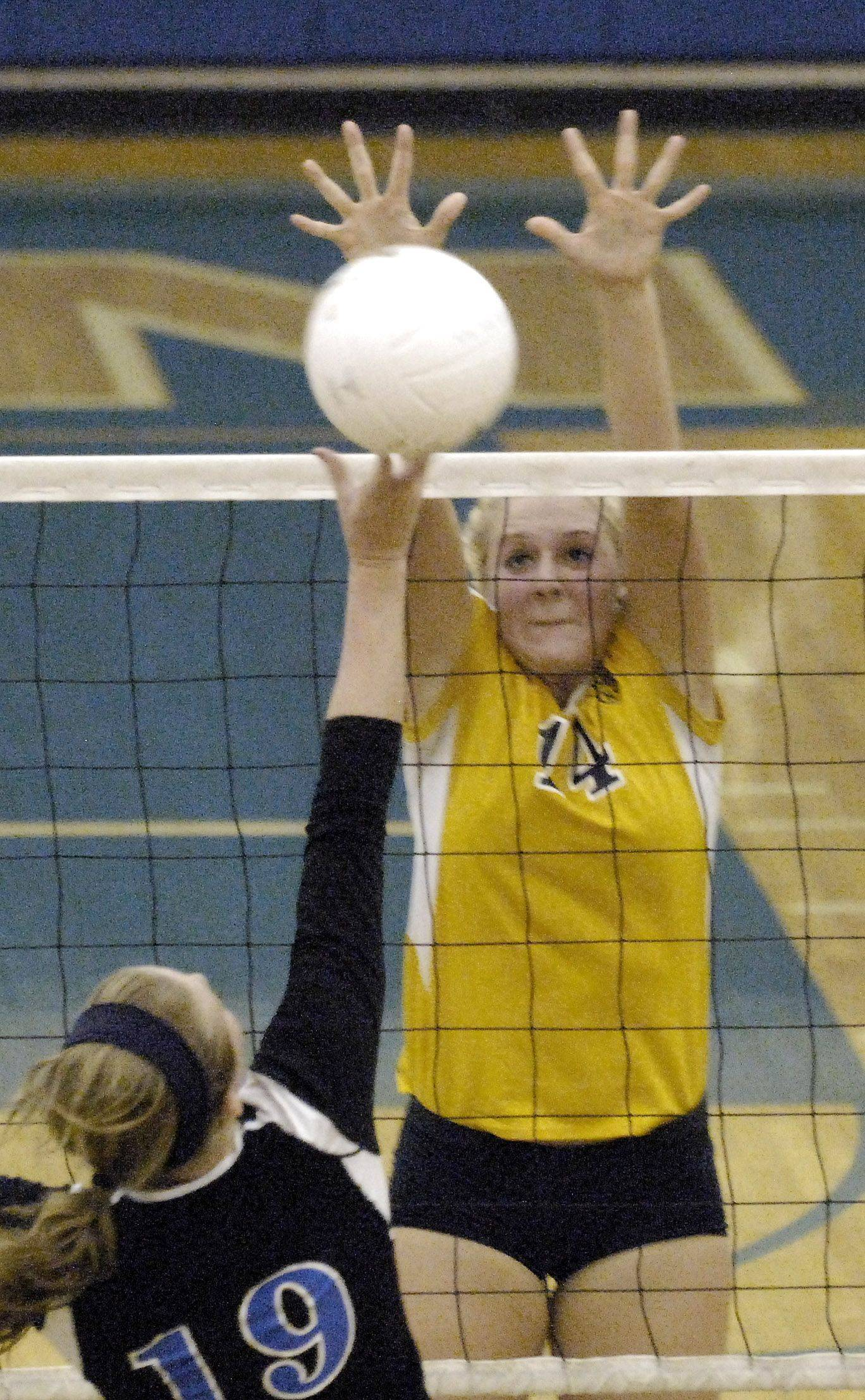 Neuqua Valley's Kaitlynn Novak goes up for the block of a hit by Geneva's Melissa Hanika during Thursday's game in Geneva.