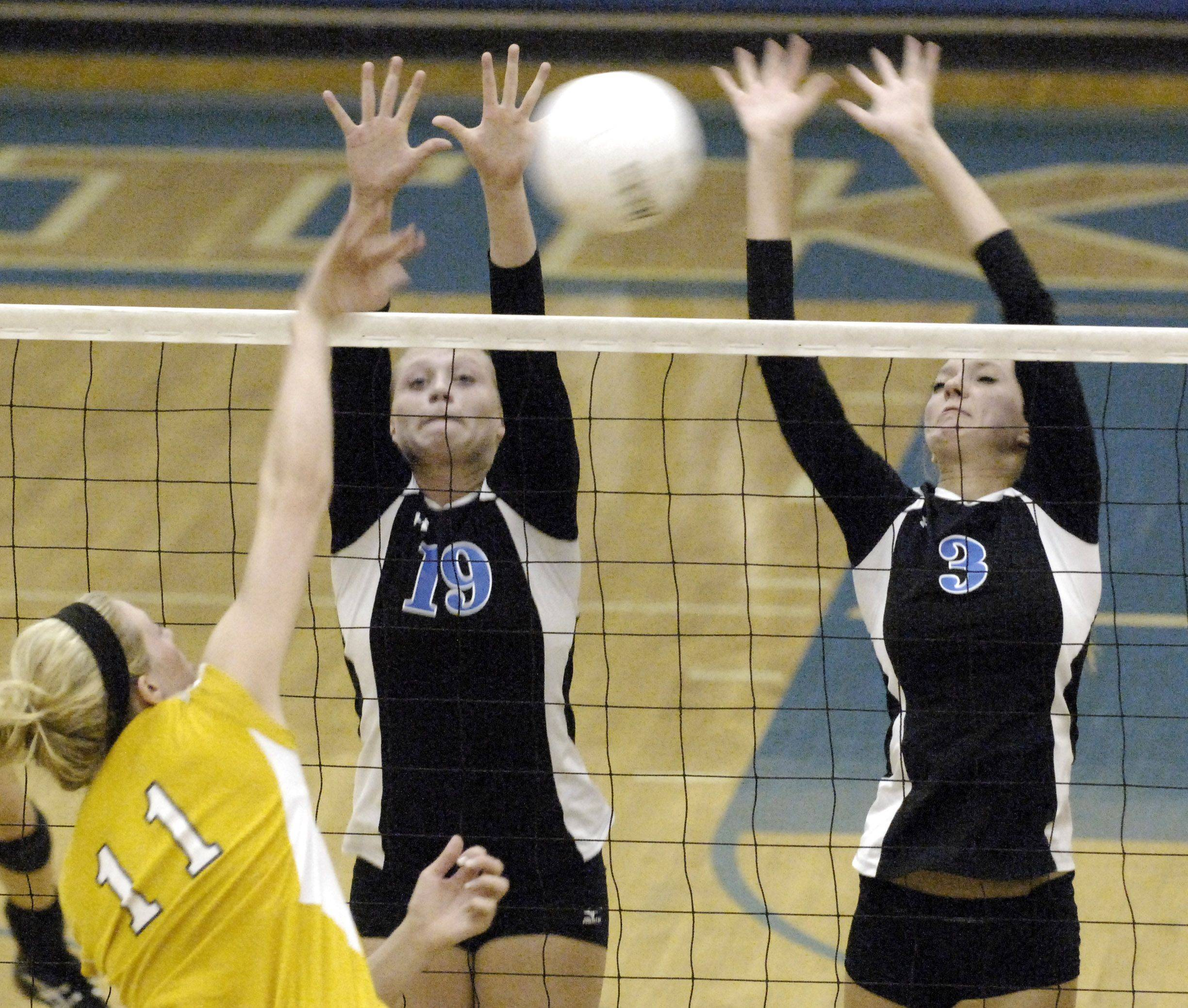 Geneva's Melissa Hanika, left, and Taylor Otto go up to block a spike by Neuqua Valley's Callie Huebener during Thursday's game in Geneva.