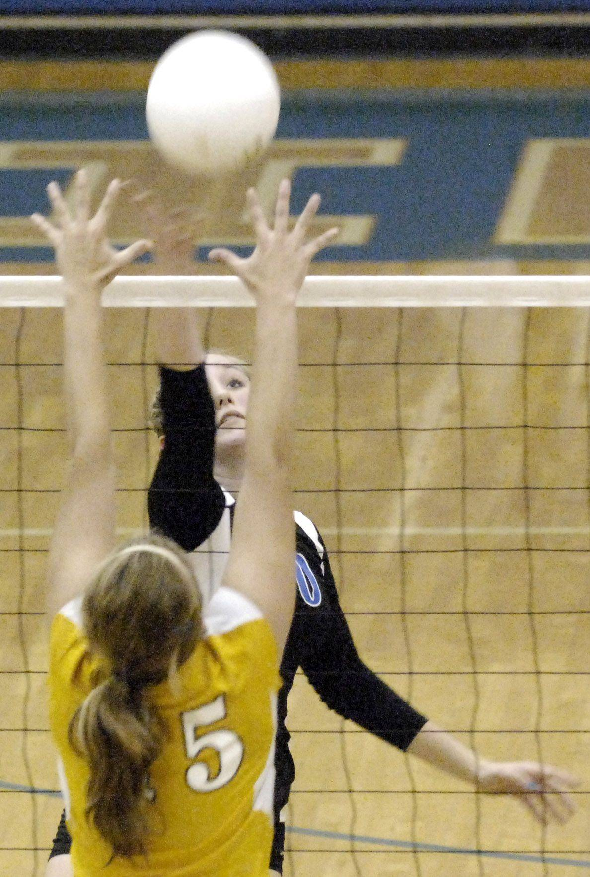 Geneva's Tess Forneris hits the ball past Neuqua Valley's Taylor McKeown during Thursday's game in Geneva.