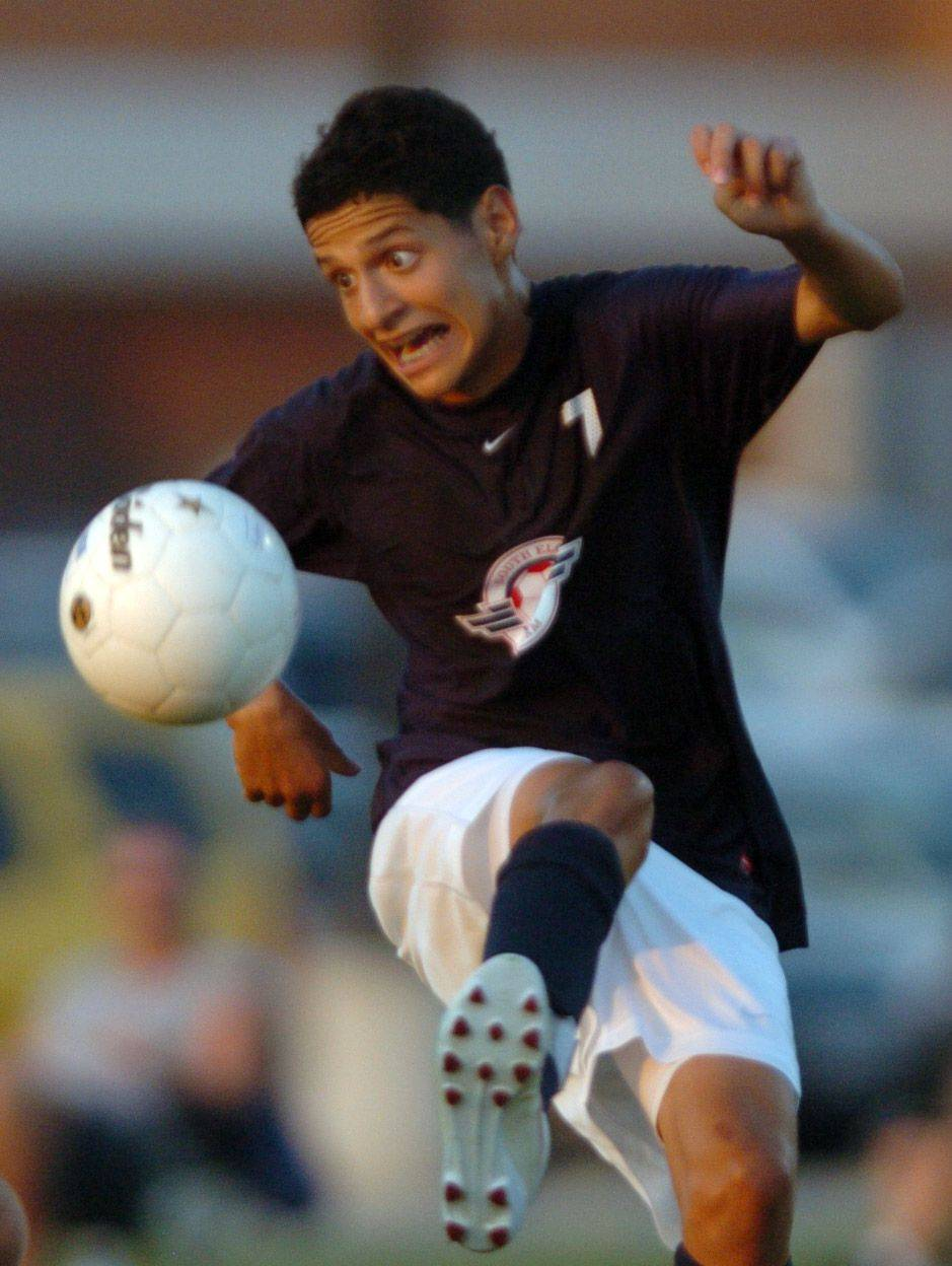Miguel Valle of South Elgin, traps the ball during the South Elgin High School and Hampshire High School Boys Soccer Game at Hampshire High School, on Thursday.