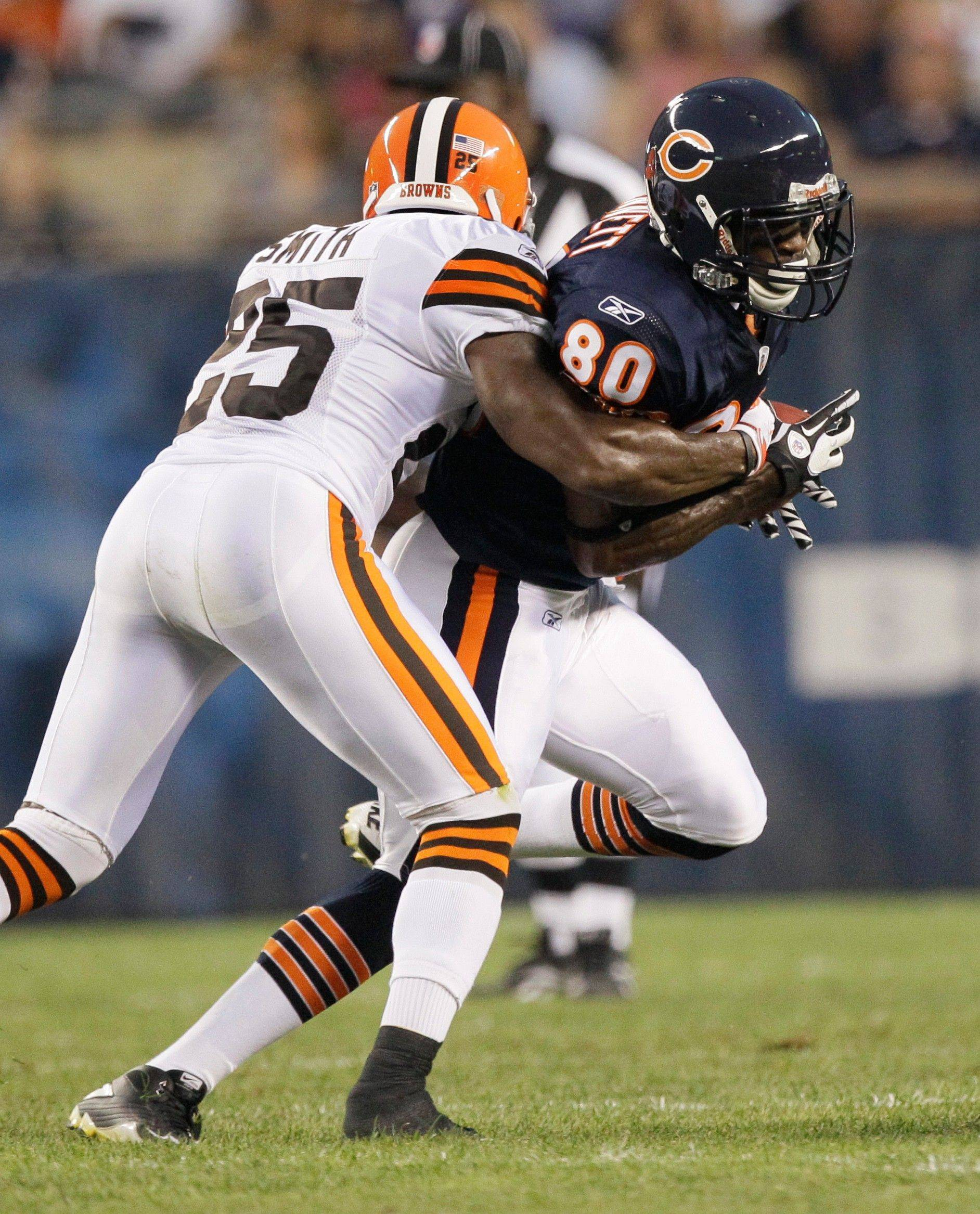 Chicago Bears wide receiver Earl Bennett is tackled by Cleveland Browns defensive back DeAngelo Smith after a reception in the first half.