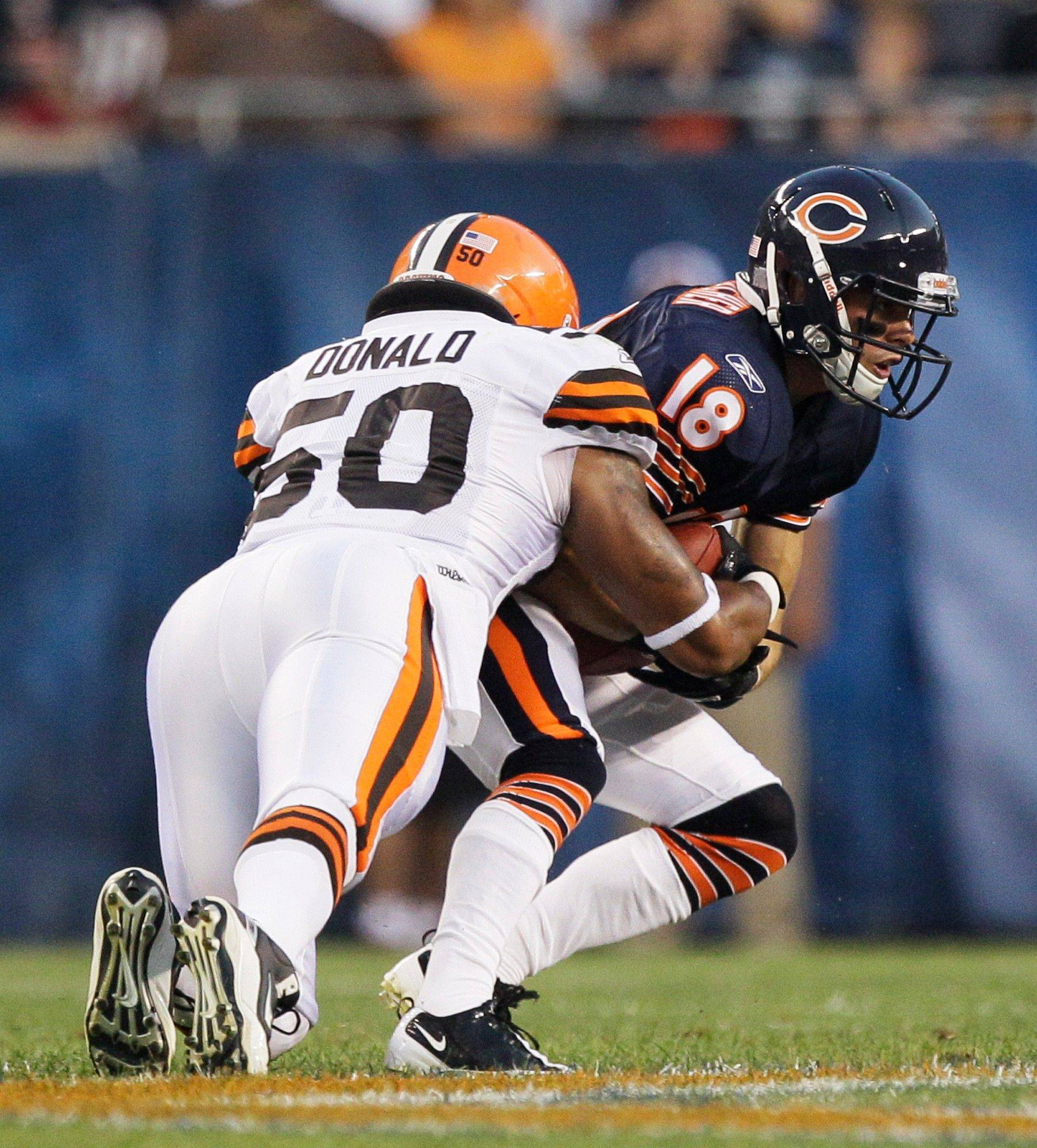 Chicago Bears wide receiver Dane Sanzenbacher is tackled by Cleveland Browns linebacker Archie Donald in the first half.