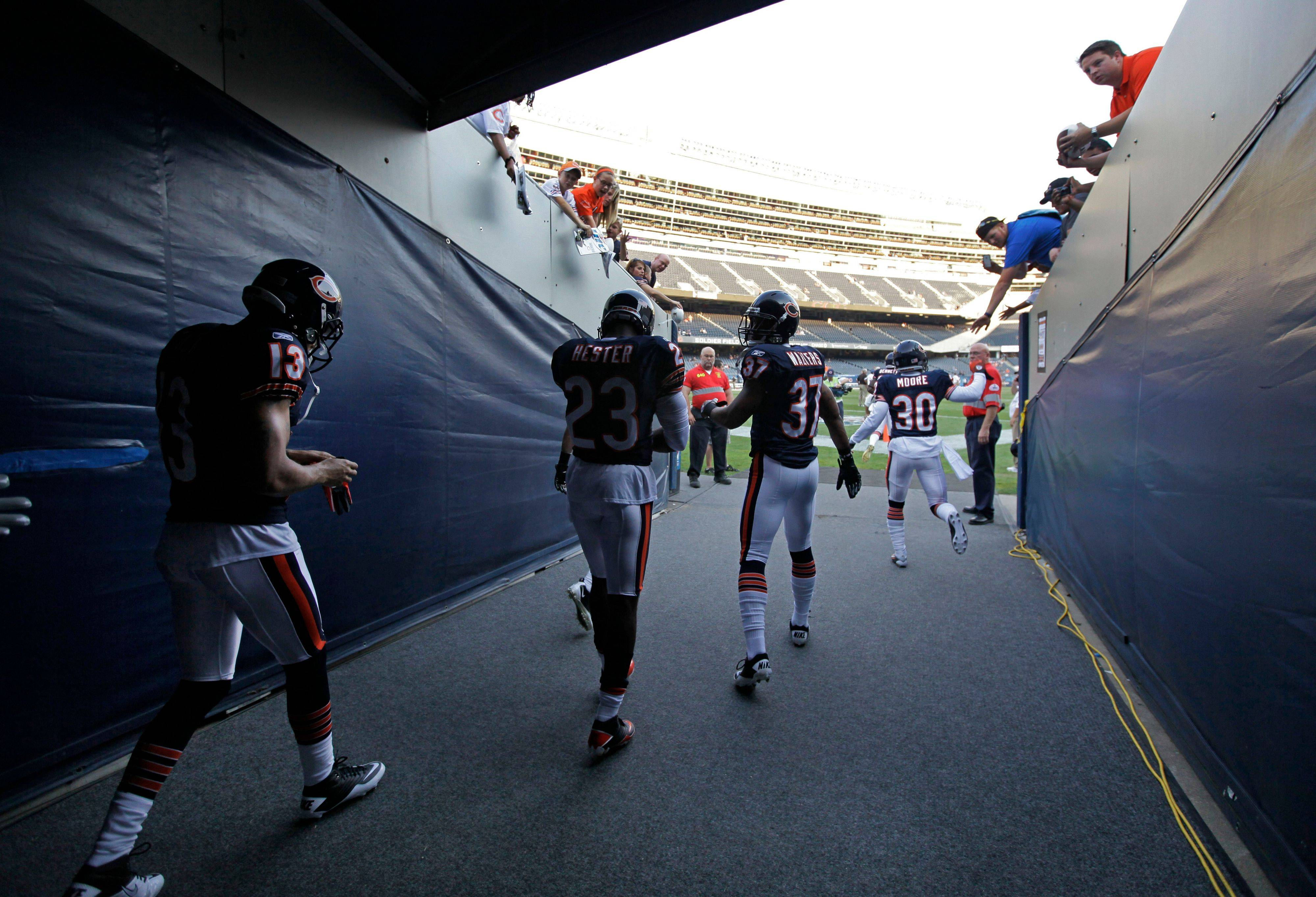 Chicago Bears receivers Johnny Knox, Devin Hester, safety Anthony Walters and cornerback D.J. Moore head to the field for warm-ups.