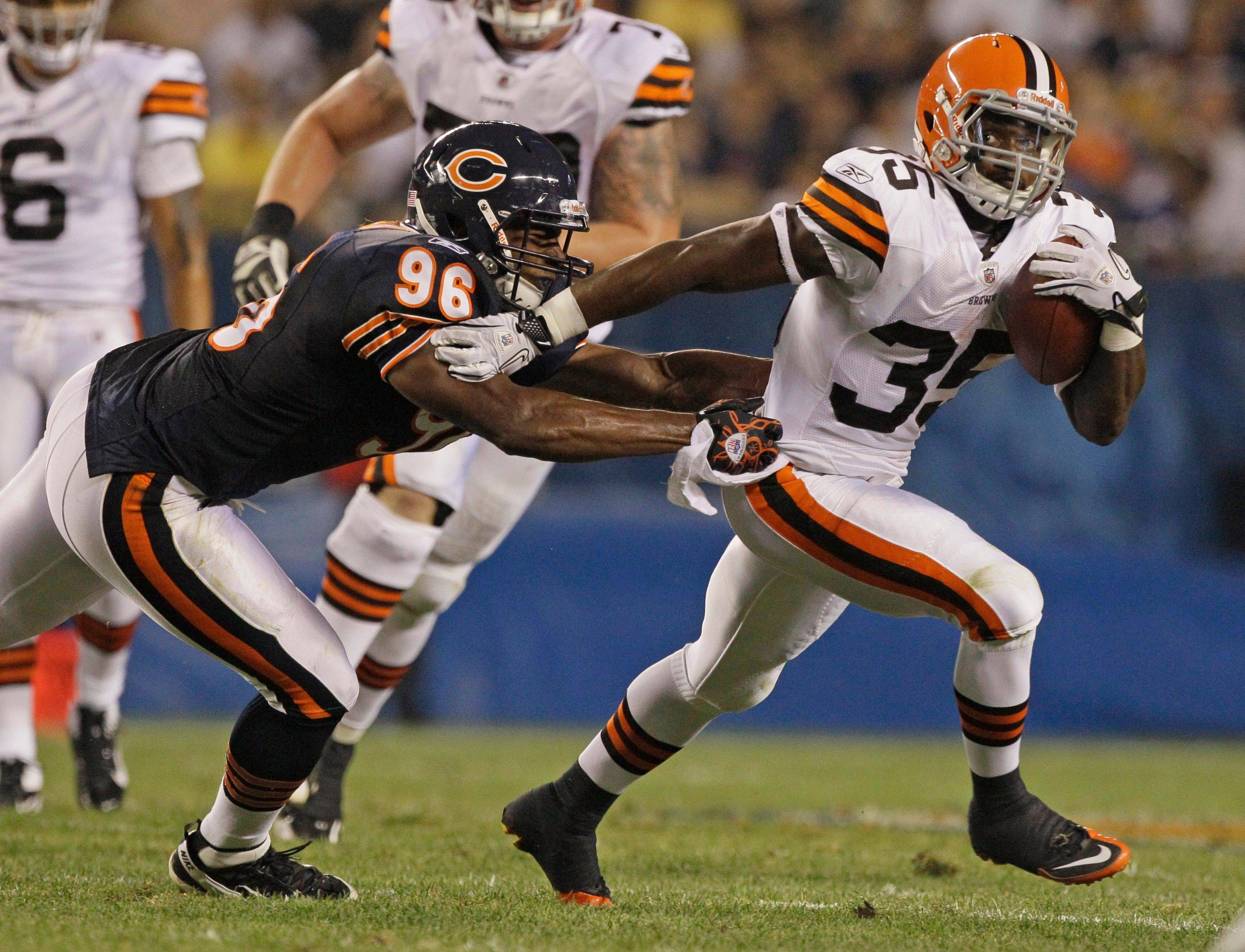 Cleveland Browns running back Armond Smith tries to break the arm tackle of Chicago Bears linebacker Patrick Trahan in the first half.