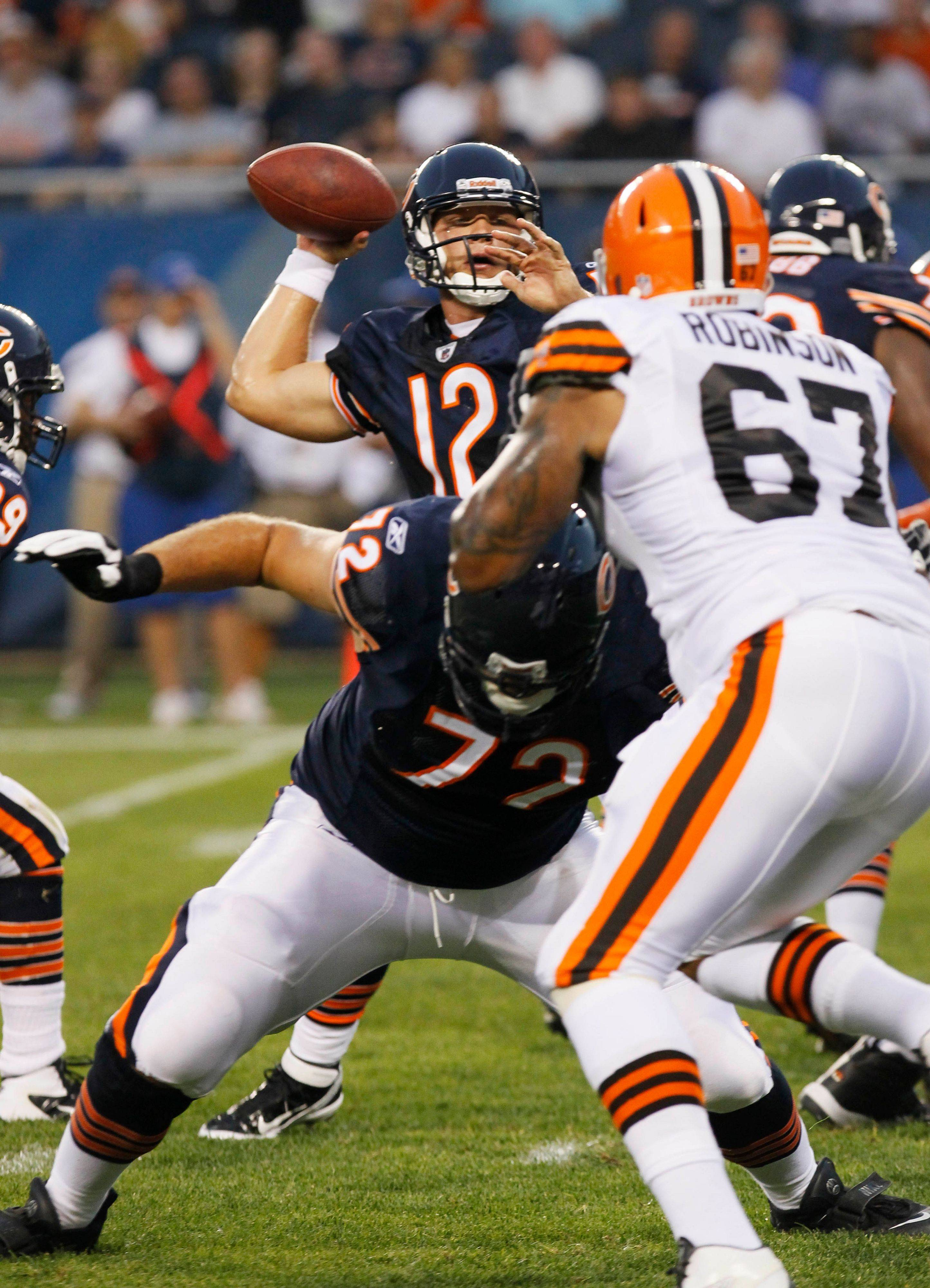 Chicago Bears quarterback Caleb Hanie prepares to pass as teammate Gabe Carimi blocks Cleveland Browns defensive end Derreck Robinson in the first half.