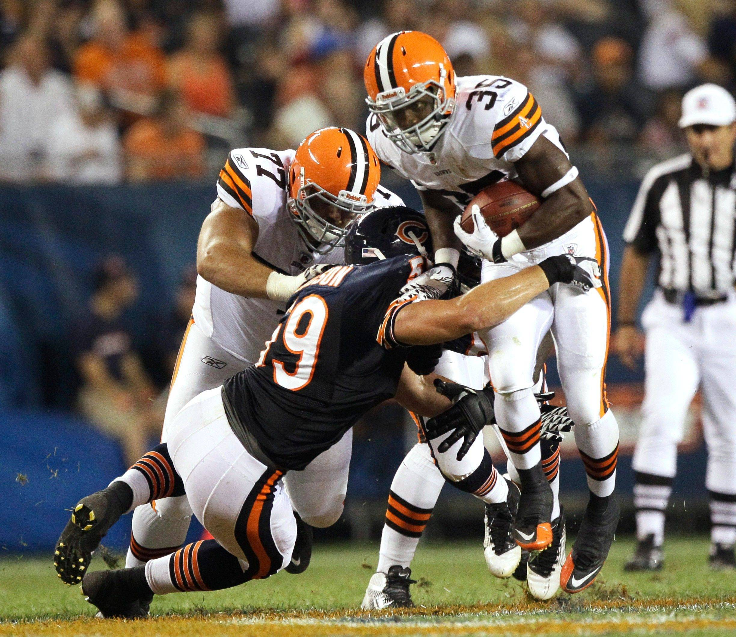 Cleveland Browns running back Armond Smith is tackled by Chicago Bears linebacker Chris Johnson in the first half.