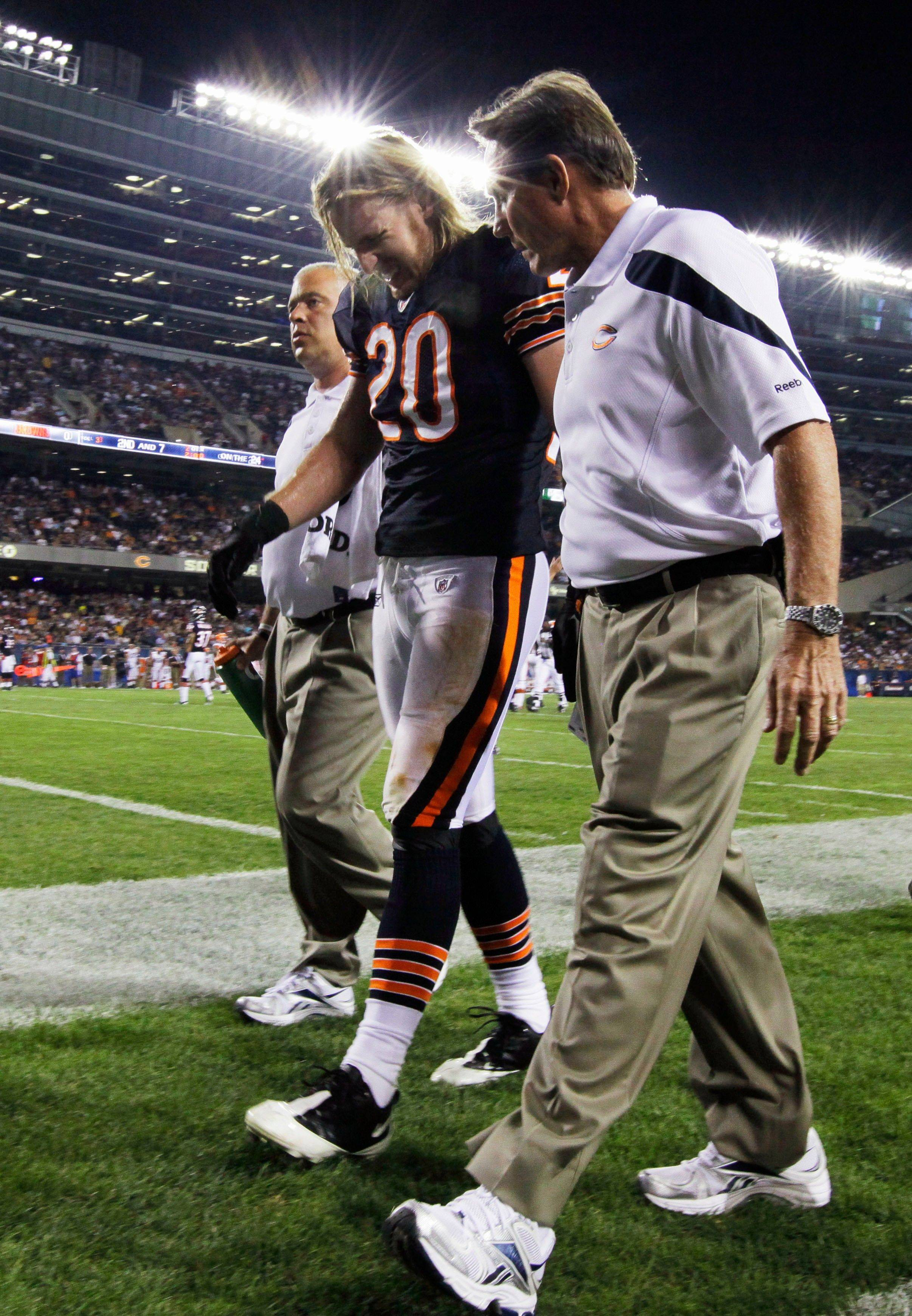 Chicago Bears safety Craig Steltz is helped from the field after getting injured in the first half .