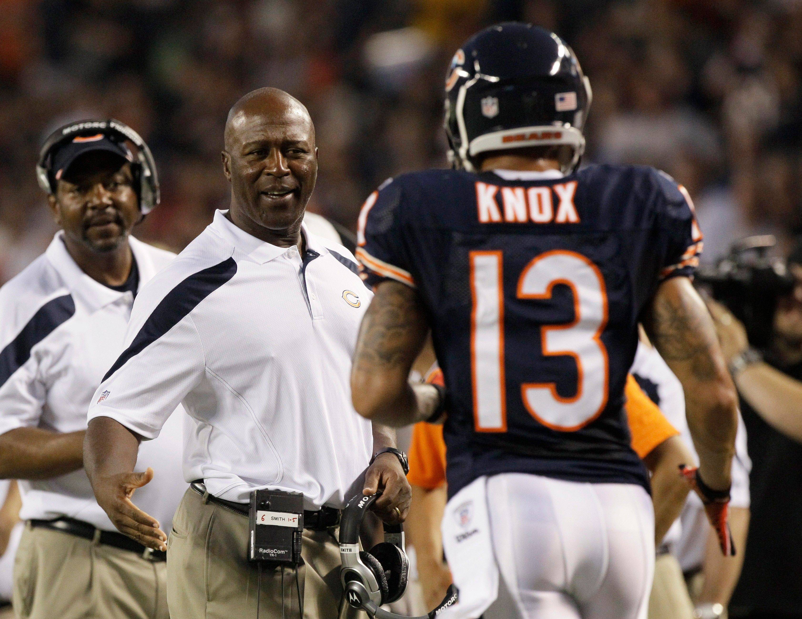 Chicago Bears wide receiver Johnny Knox is greeted on the sidelines by head coach Lovie Smith after his touchdown reception against the Cleveland Browns in the first half.