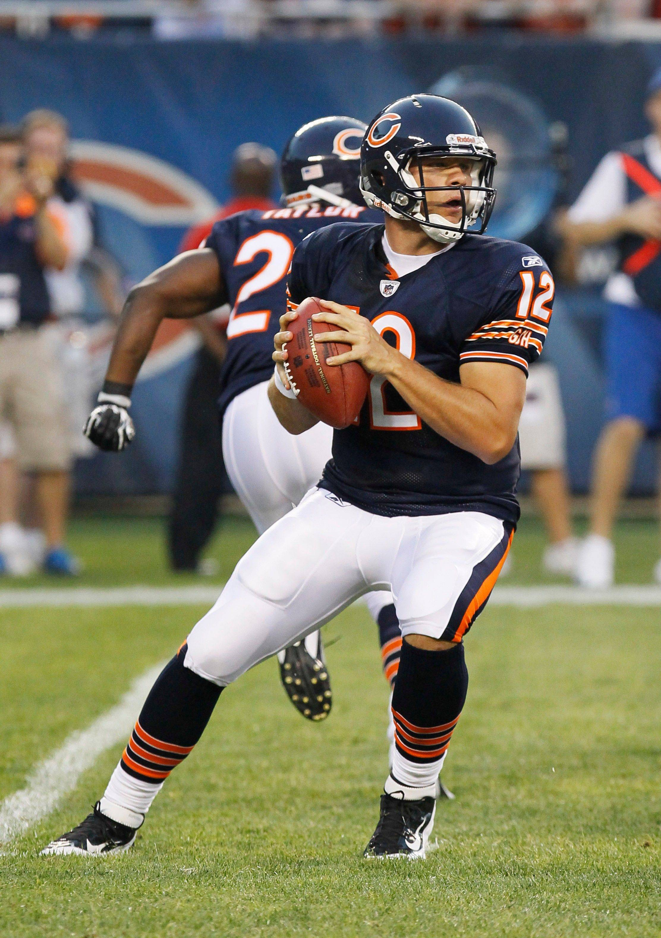 Chicago Bears quarterback Caleb Hanie looks for a receiver in the first half.