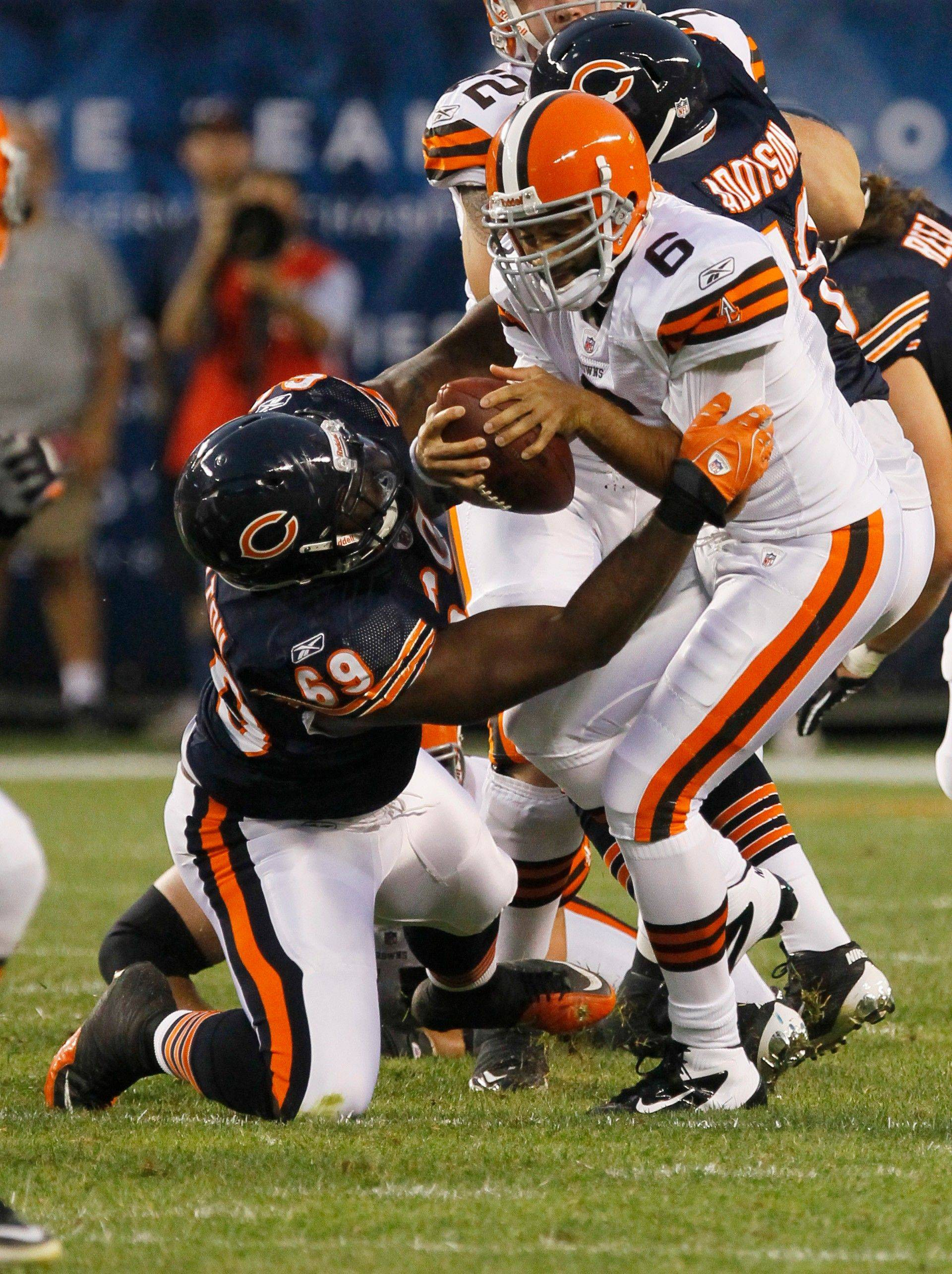 Cleveland Browns quarterback Seneca Wallace is sacked by Chicago Bears guard Ricky Henry in the first half.