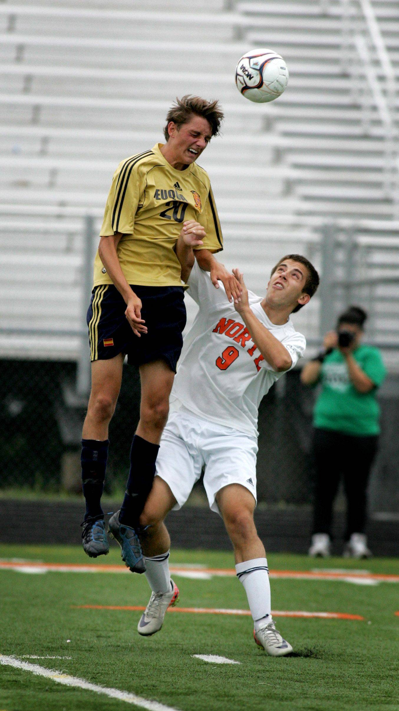 Stephan Kovacevic of Neuqua Valley, left, gets to the header over Nanad Komljenovic of Naperville North in boys soccer action Tuesday in Naperville.