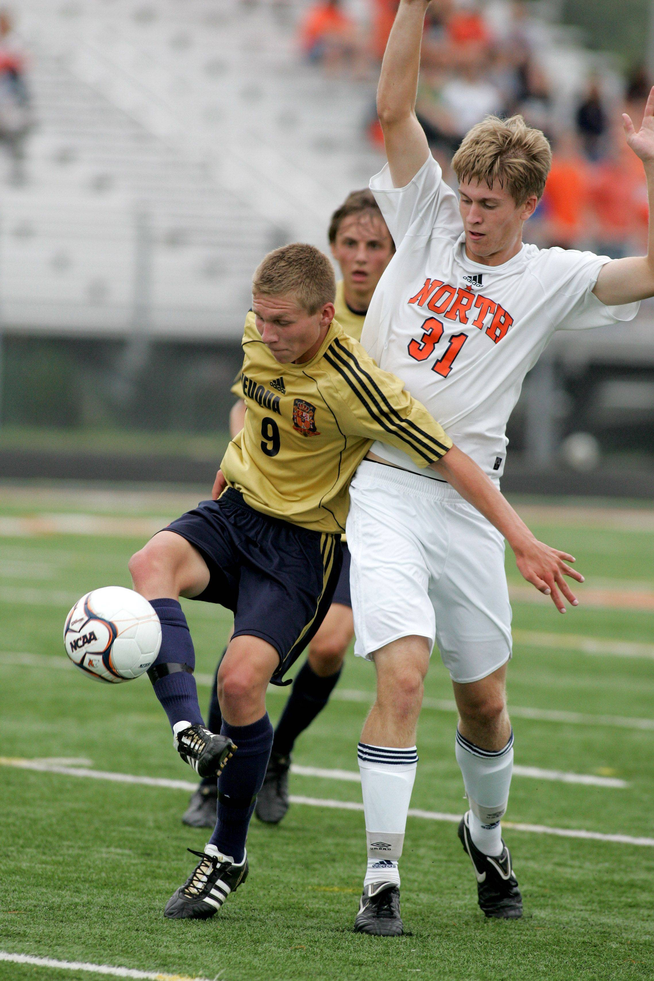 Alex Vanags, left of Neuqua Valley and Kyle Lindberg, right of Naperville North in boys soccer action Tuesday in Naperville.