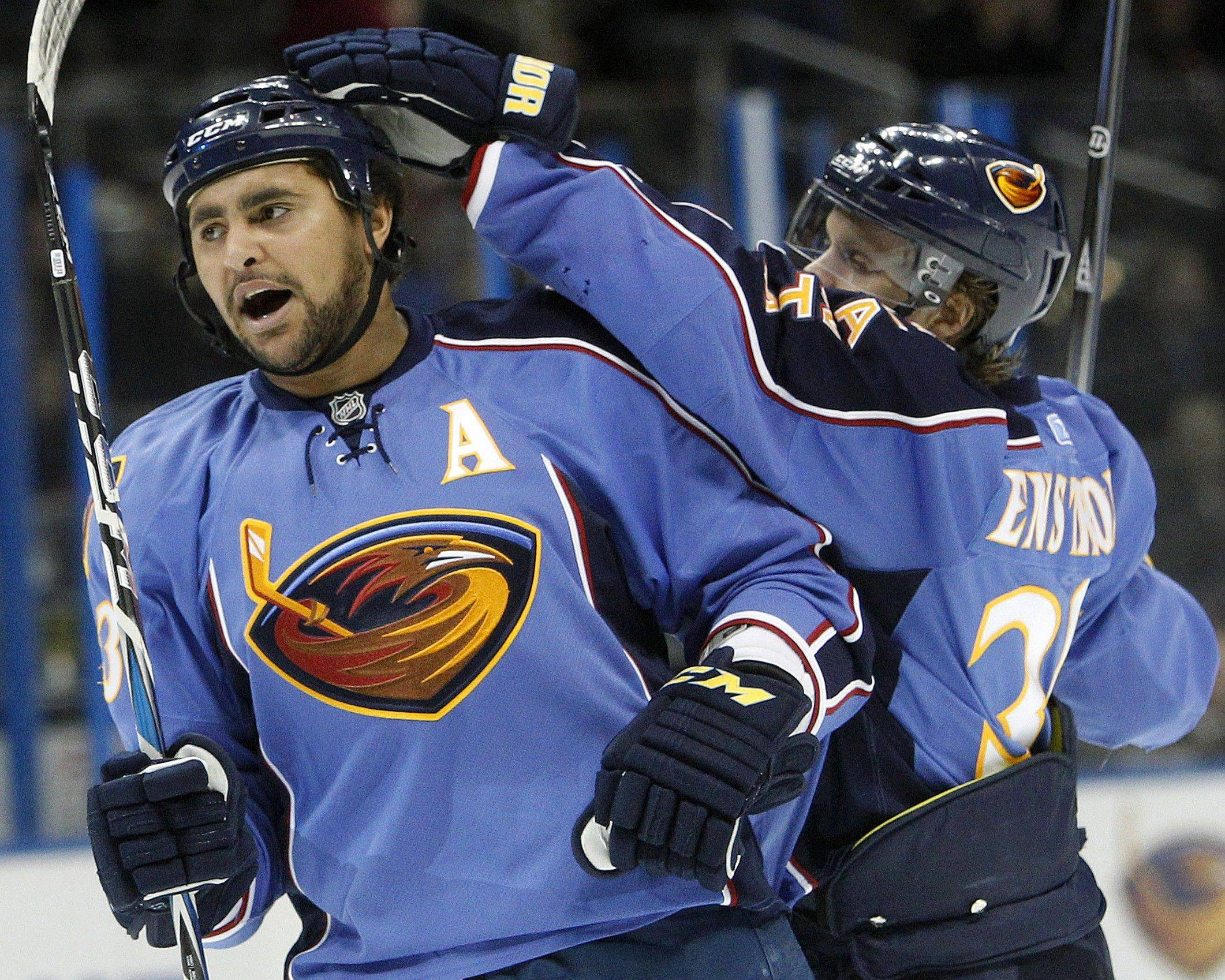 While charges have not been formally filed, NHL defensemen Dustin Byfuglien, left, was arrested in a boating incident on suspicsion of boating while intoxicated. The former Blackhawks and Atlanta Thrashers star is now with the Winnipeg Jets.