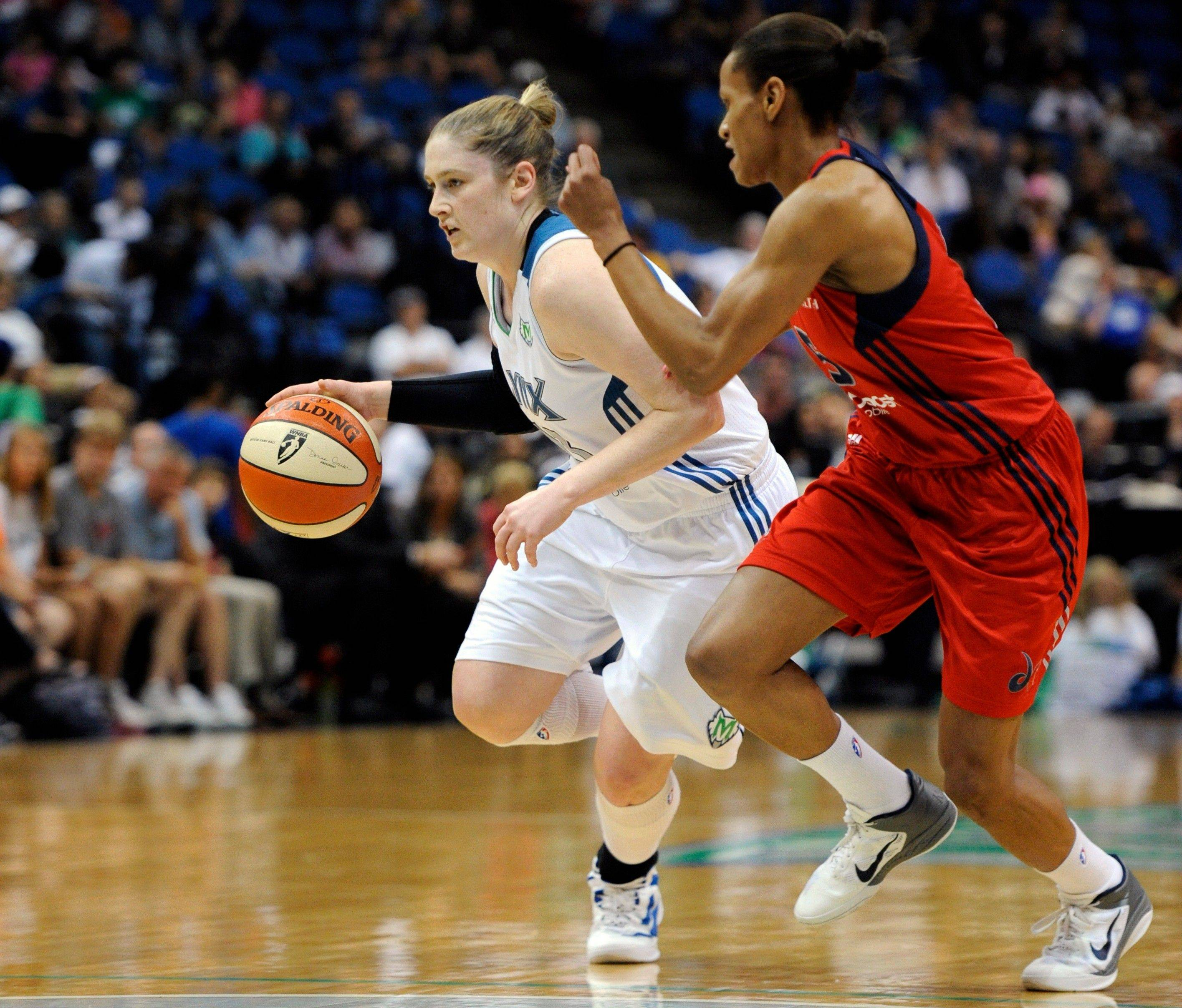 Minnesota Lynx's Lindsay Whalen (13) dribbles against Washington Mystics' Jasmine Thomas (5) during the first quarter of a WNBA basketball game in Minneapolis on Tuesday.