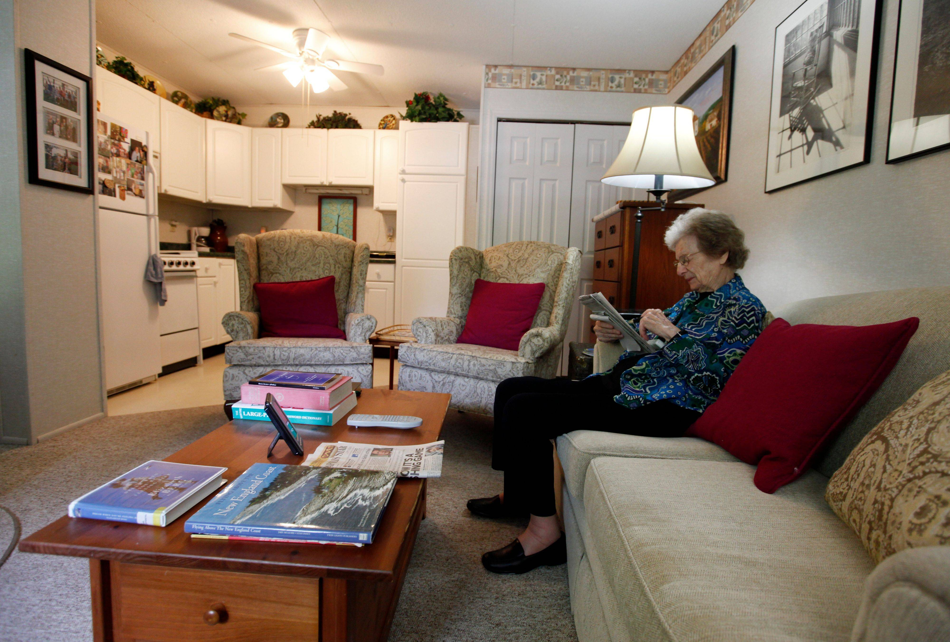 Jane Merrill works a crossword puzzle in her �apartment� in the home of her son, William Merrill, in Carmel, Ind. The Merrill family had their two-car garage renovated to create a mother-in-law suite for Jane.