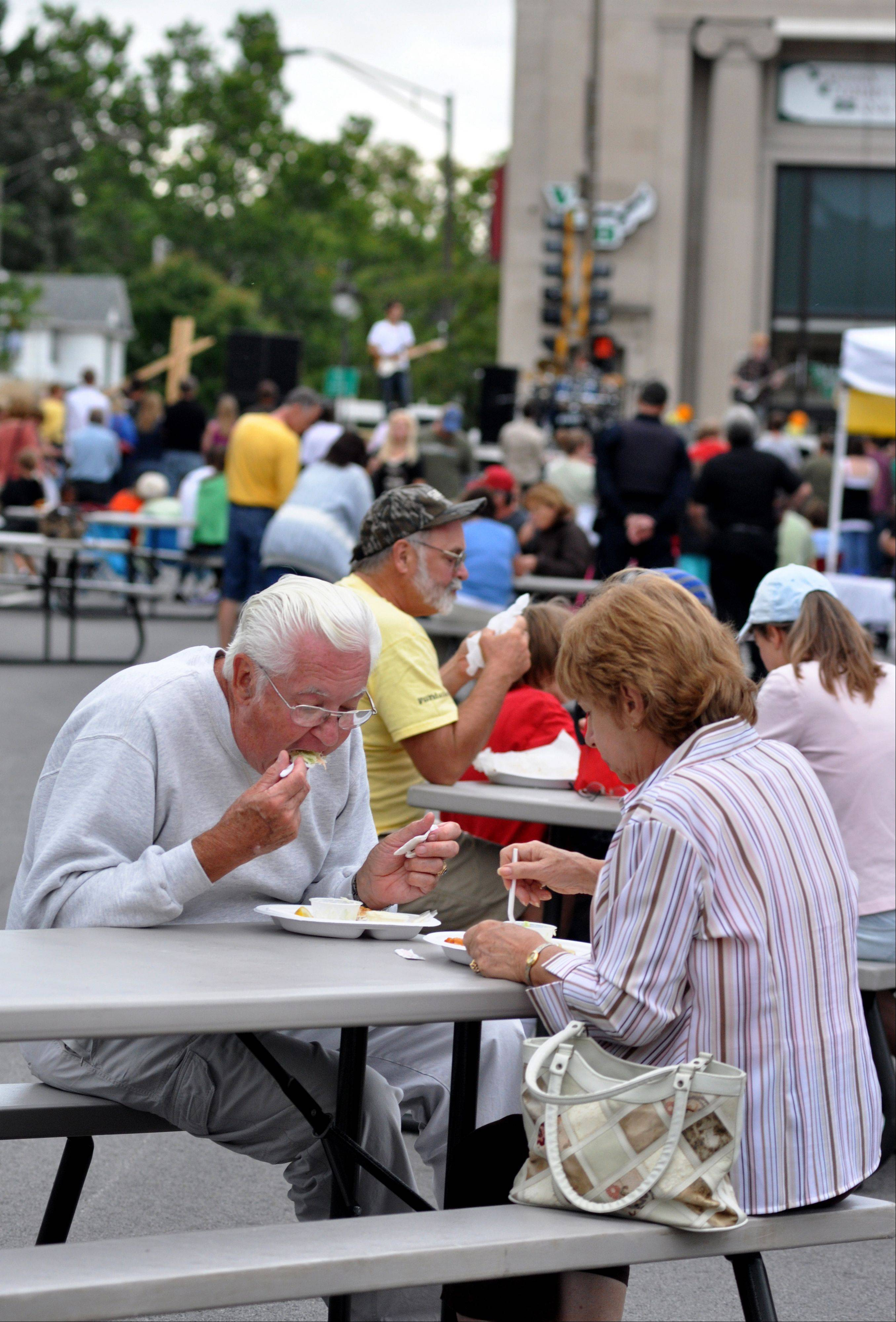 Rich Franden and Diane Garland from Batavia feast at last year�s Downtown Batavia Block Party. This year�s event, set for Sunday, will feature food from 11 restaurants.